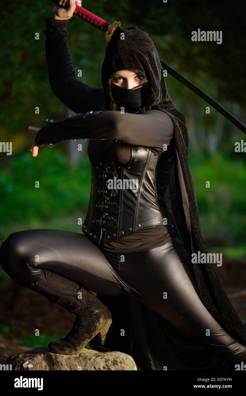 Female ninja in battle - Stock Image