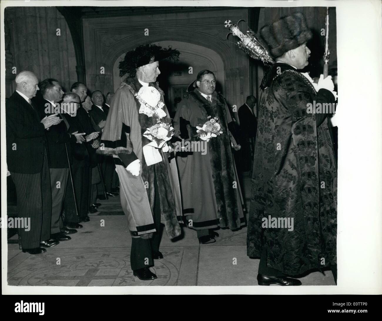 Sep. 09, 1960 - Election of the new Lord Mayor: The New Lord Mayor of London Sir Bernard Walley Cohen (holding nosegay, on right) 46 year old farmer and company director walks in procession with the retiring Lord Mayor (Sir Edmund Stockdale) (holding nosegay, left) during the election ceremony in the London Guildhall, Carrying the traditional nosegay is a custom dating back to the 17th. century since when after the plague of London ins 1665, they have been carried on this and similar occasions. - Stock Image