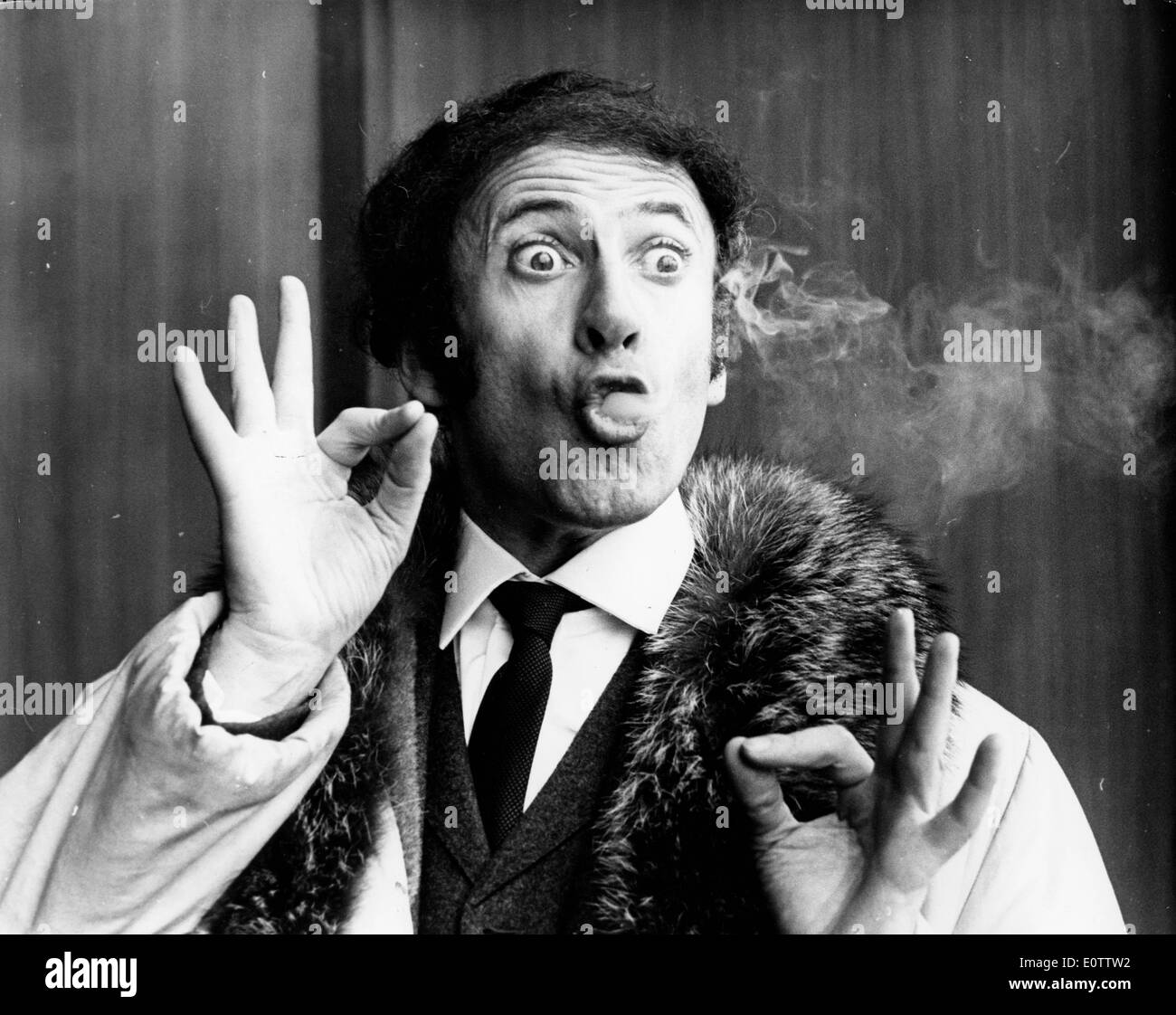 French mime Marcel Marceau blowing smoke out of his mouth - Stock Image