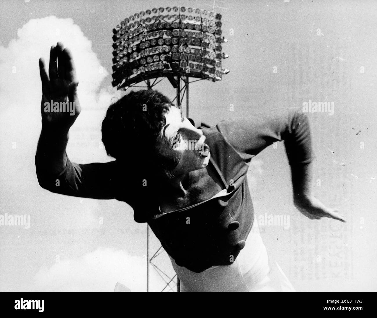 French mime Marcel Marceau in the air during a performance - Stock Image