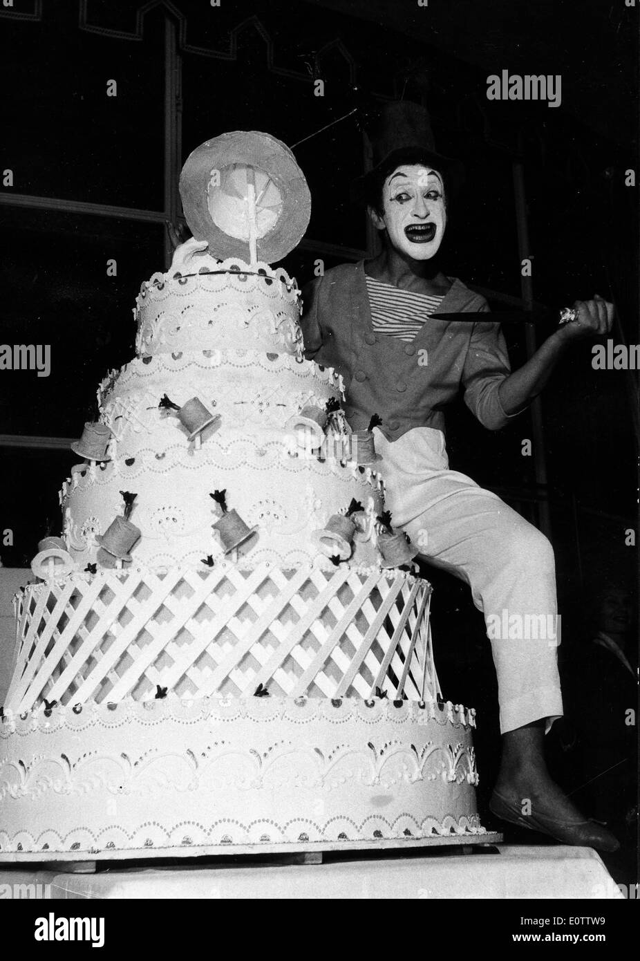 French mime Marcel Marceau cutting a cake - Stock Image