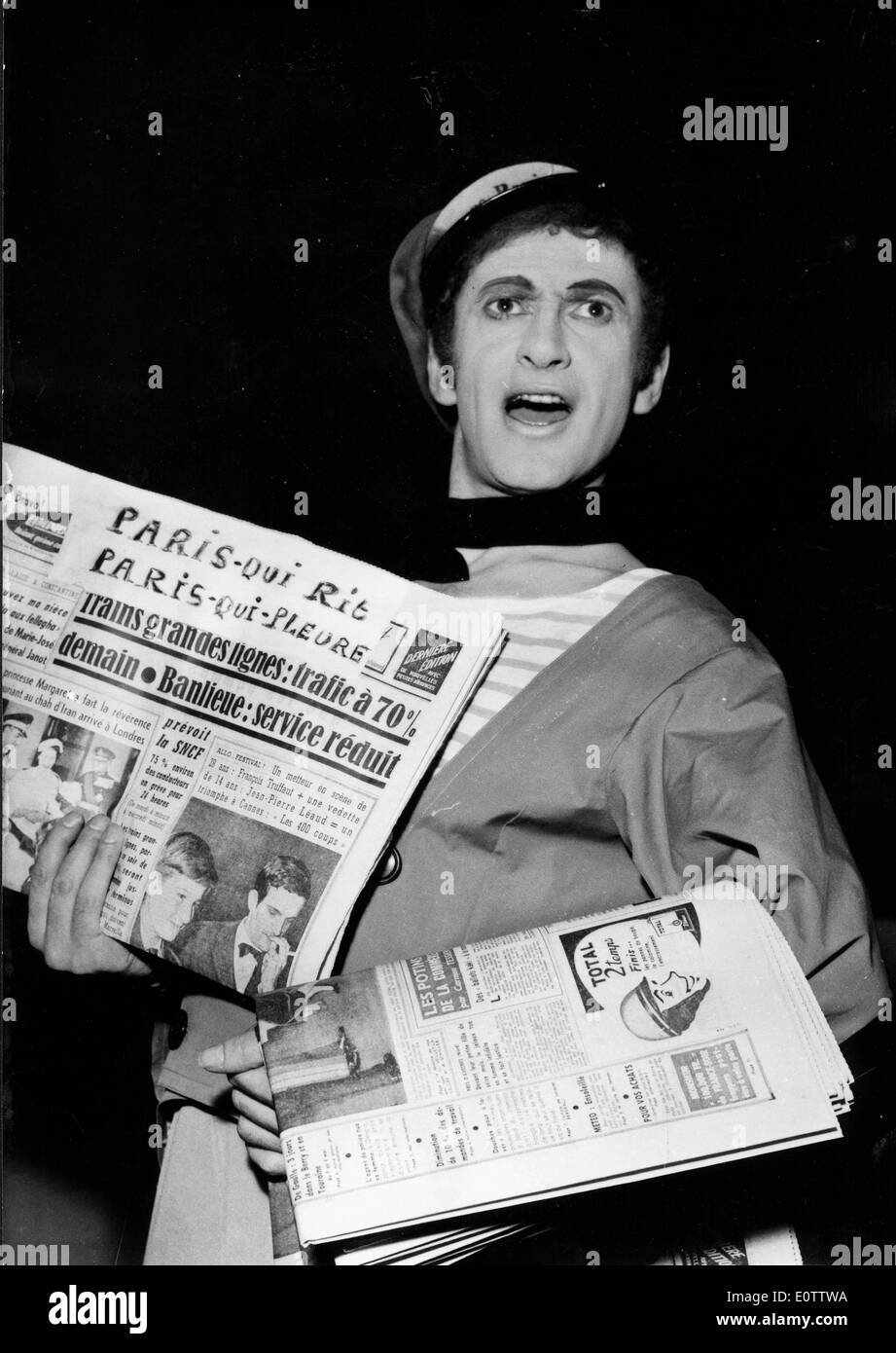 French mime Marcel Marceau carrying newspapers Stock Photo