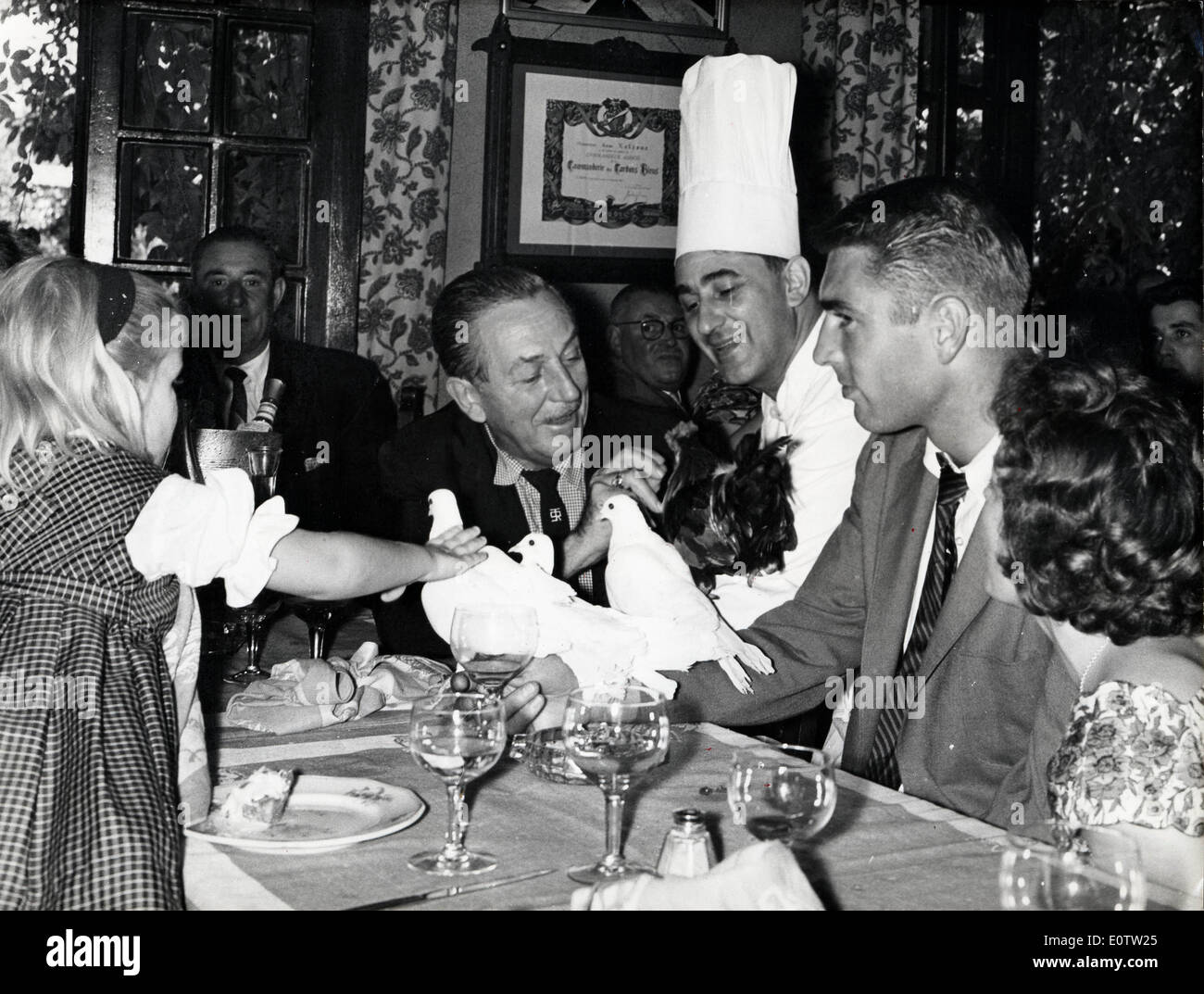 Walt Disney having a meal with friends and live animals Stock Photo