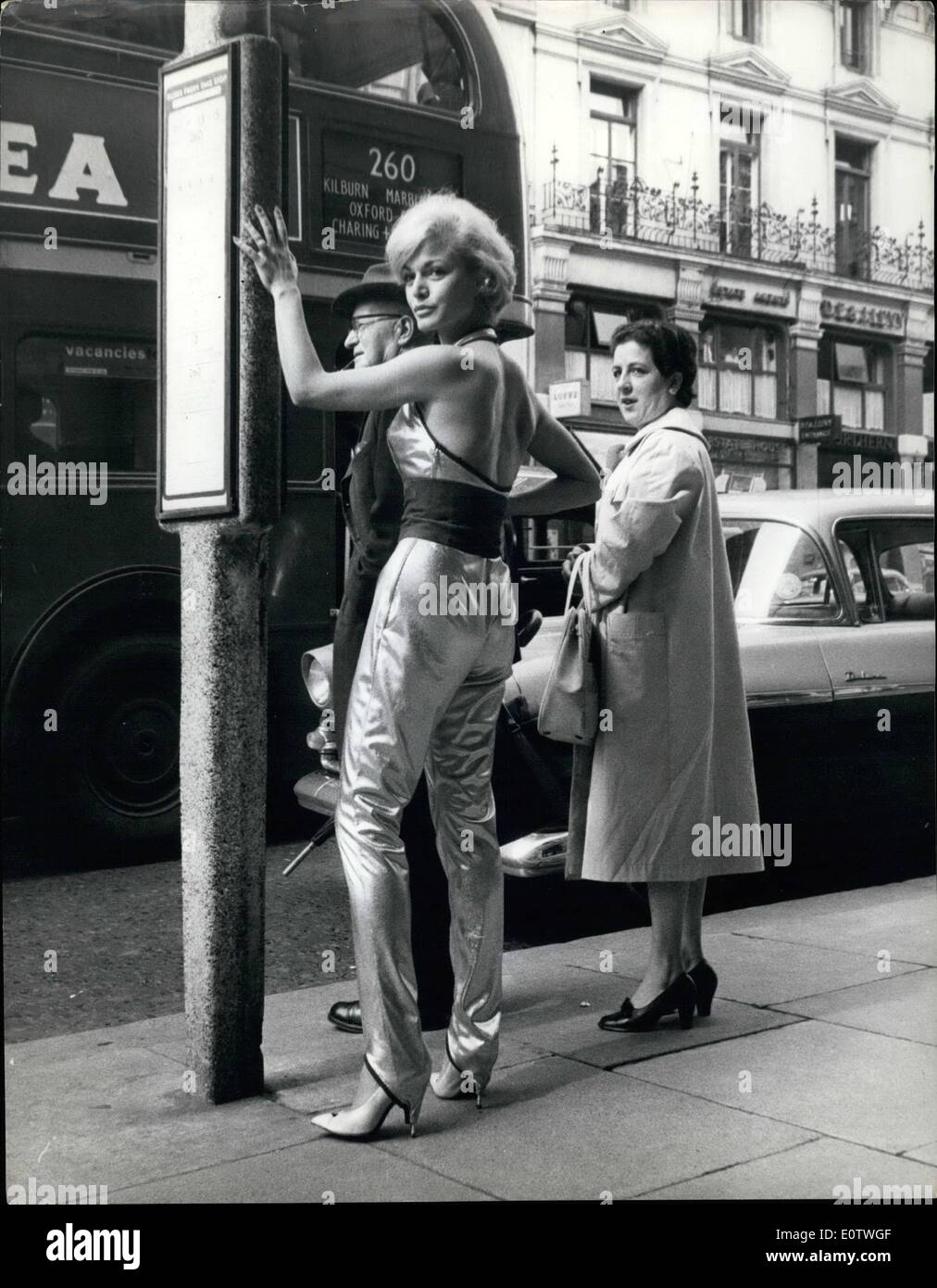 Aug. 08, 1960 - The Girl With The 250 Guinea Pants: German actress Margit Saad, pictured in London yesterday wearing tight fitting silk pants sprayed with 24 carat gold, and coasting 250 guineas. Margit will wear the pants for only 2 1/2 minutes in Tony Hancock's new film ''The Rebel'', in which she plays the part of his girl friend. - Stock Image