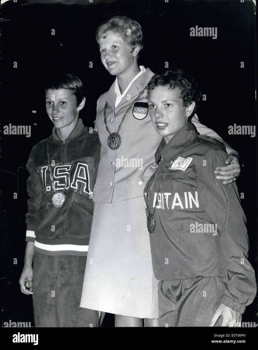 Aug. 08, 1960 - Olympic Games In Rome Diving Winners With Their Medals; Photo Shows Pictured on the rostrum after the Women's spring board diving finalin Rome are I. Kramer, of Germany (Gold Medal), centre; P. Pope (U.S.A.) Silver Medal (on left), and E. Ferris (Great Britain (Bronze Medal), on right. - Stock Image