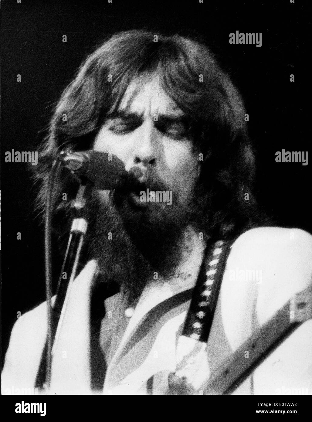 Beatle George Harrison during a performance - Stock Image