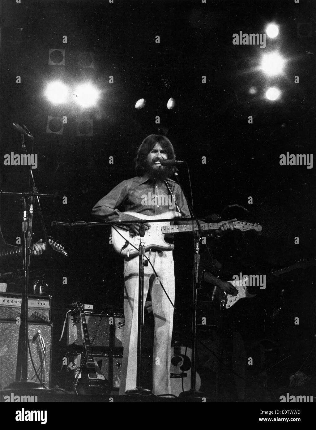 Beatle George Harrison performs in concert - Stock Image