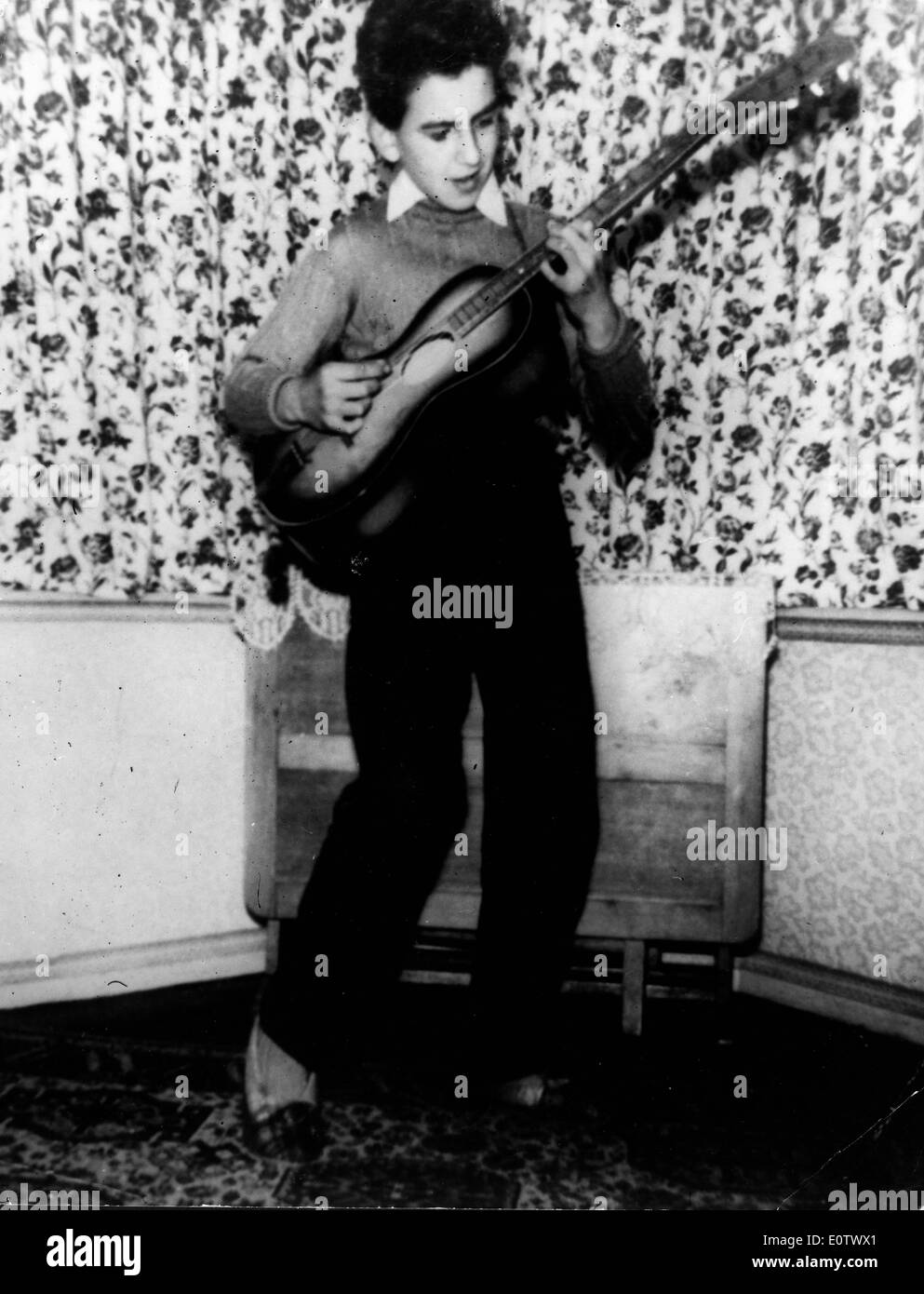 Beatle George Harrison As A Child Playing Guitar