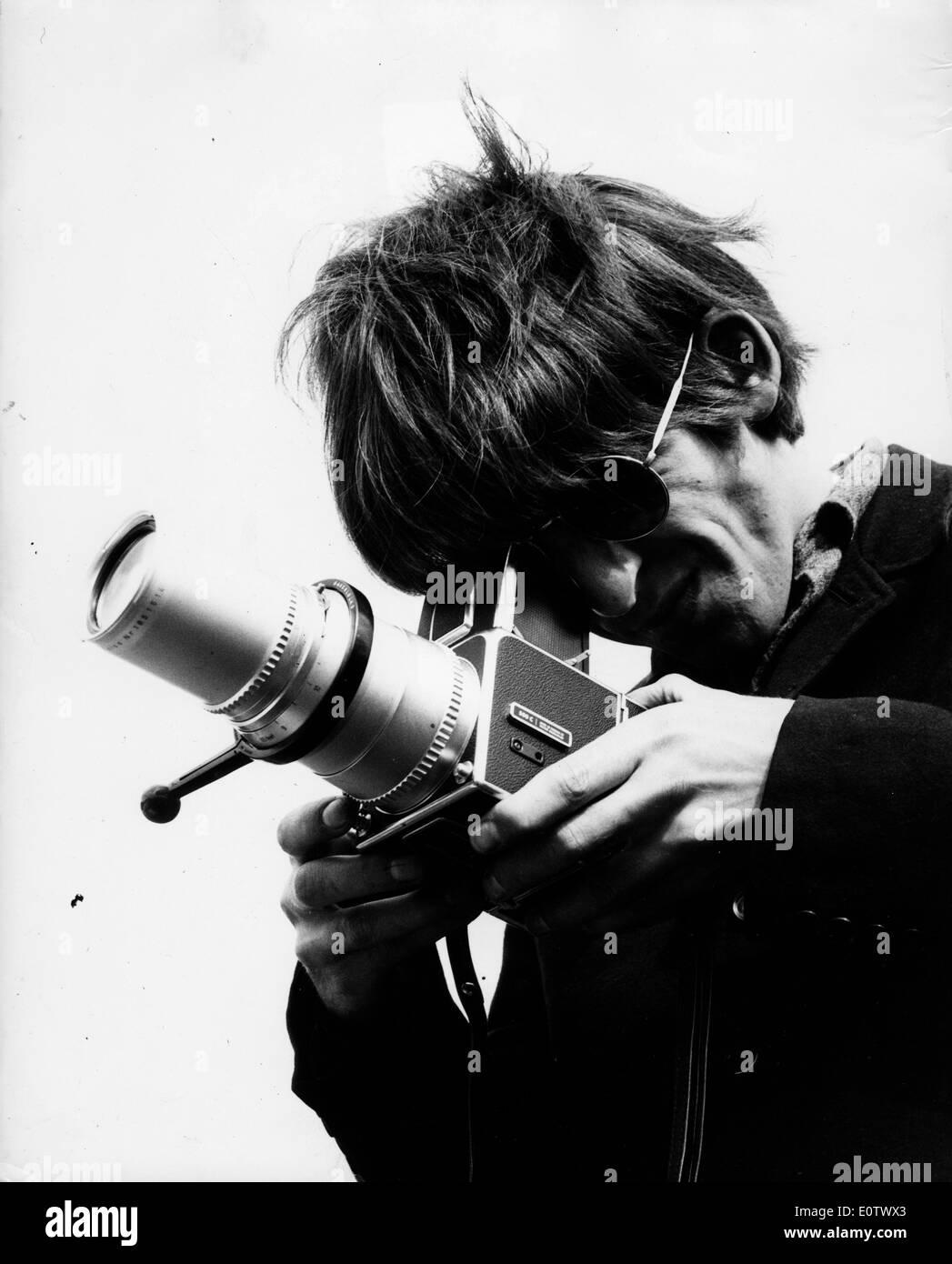 Beatle George Harrison taking photographs - Stock Image
