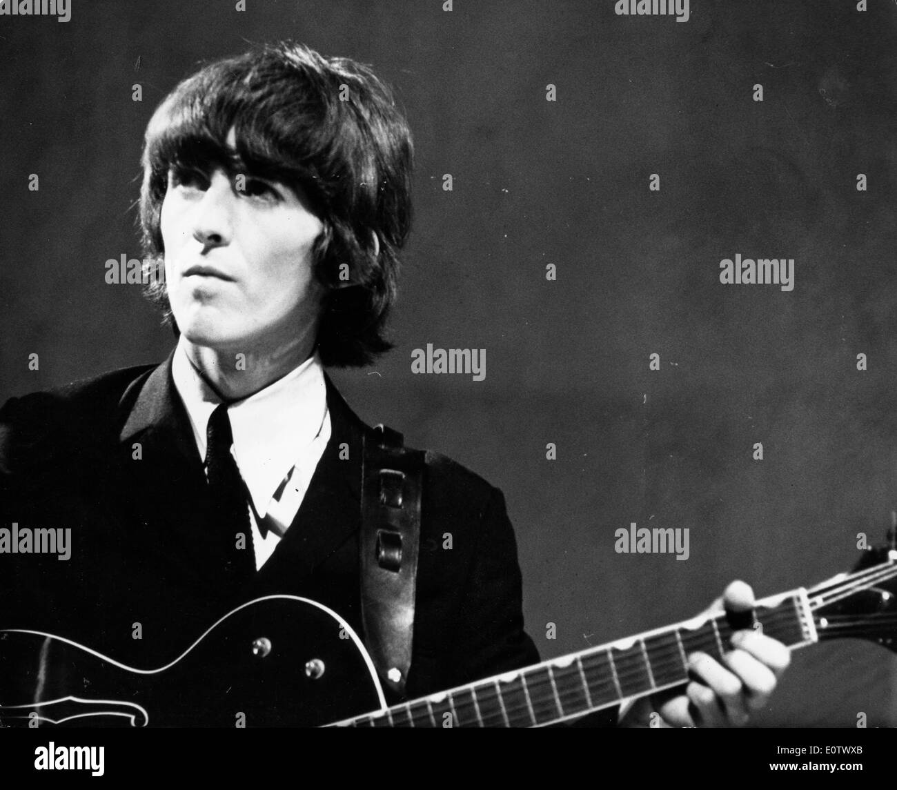 Beatle George Harrison performs at concert - Stock Image