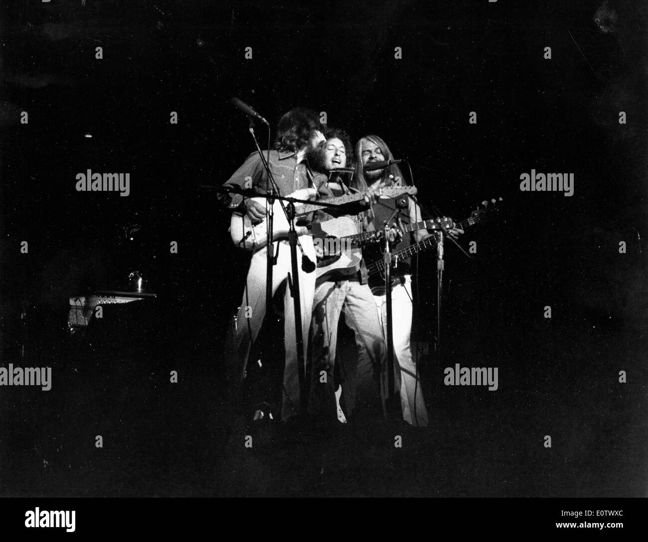 Beatle George Harrison performs with other band - Stock Image