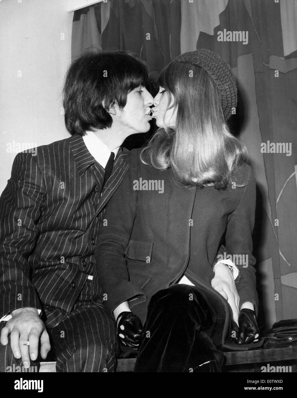 Beatle George Harrison Kisses Pattie Boyd