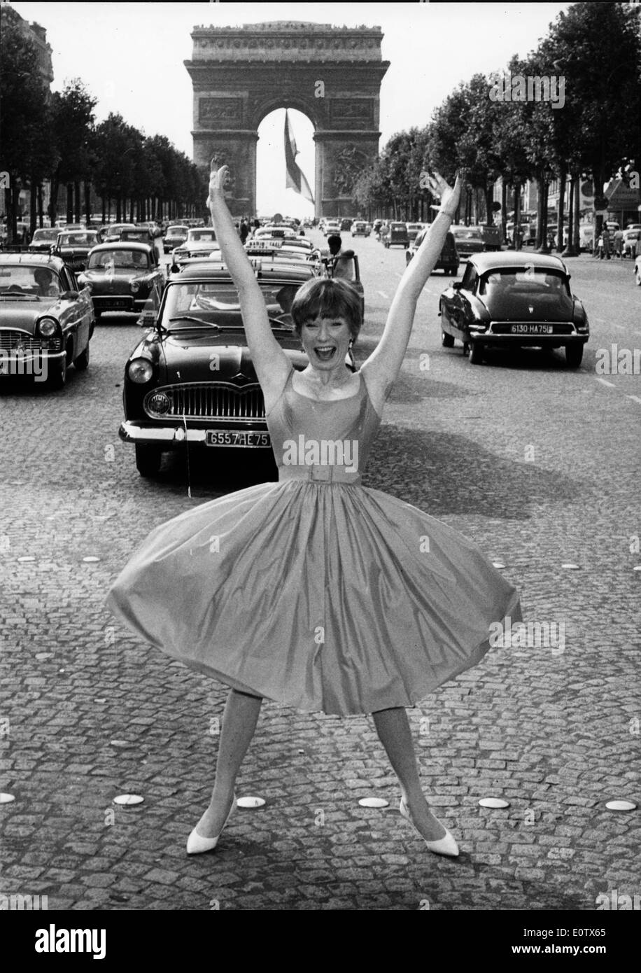 Actress Shirley MacLaine dancing in the street in Paris - Stock Image
