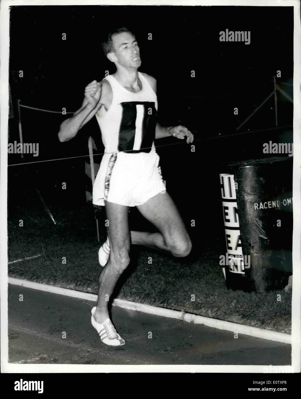 Sep. 09, 1960 - Herb Elliott Does A Sub Four Mile - Once Again: Australia's Herb Elliott won the Mile race in the London Clubs Athletic at White City in 3m.59.8 secs - his seventeenth mils in under four minutes.Second was Michael Bernard of France. Phot Shows Herb Elliott winning his mile race last night. - Stock Image