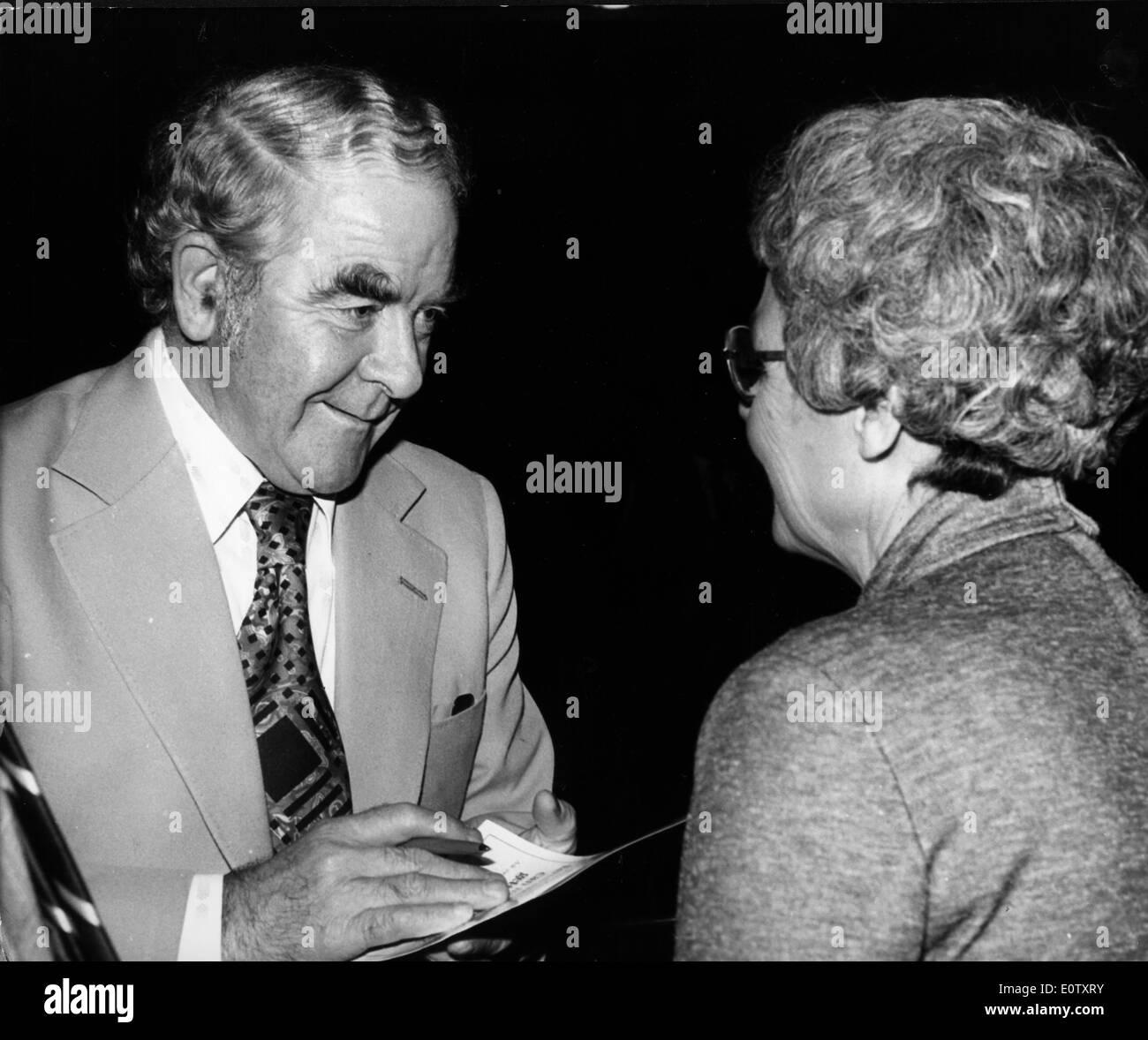 Joe Gormley signs an autograph for a woman - Stock Image