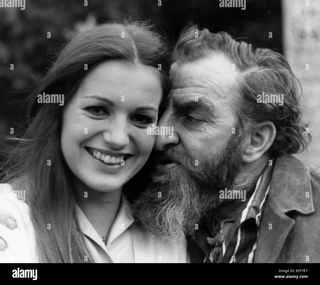 Actor Hugh Griffith hugging a young woman - Stock Image