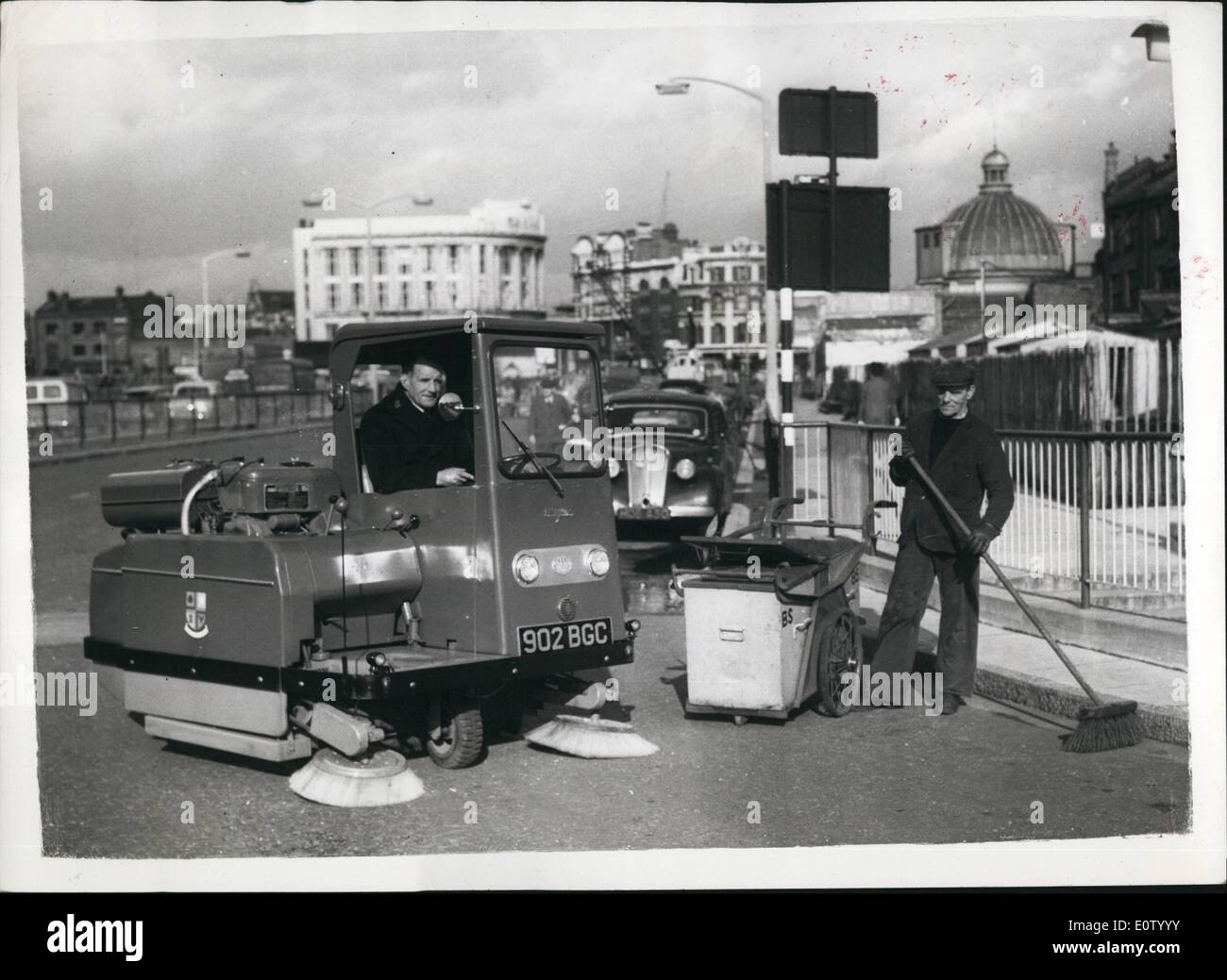 Oct. 10, 1960 - A completely new type of power sweeper, big enough to clean roads, yet sufficiently manoevrable to operate in confined spaces, has been purchased by Southwark Borough Council. Called the K.E.F. Wayne 706 it is equipped with a revolutionary type of brush mechanism that enables it to pick up anything from dust to empty bottles. The sweeper is being used in the subways at the Elephant and Castle Development Schems. Photo shows A road-sweeper works alongside the new power sweeper, during a demonstration at the Elephant and Castle today. - Stock Image