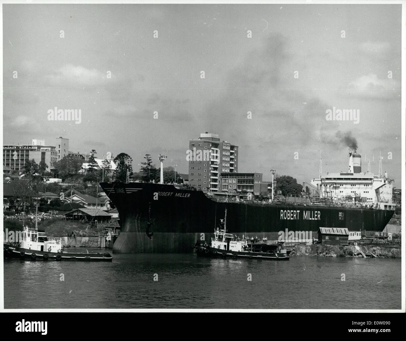 Oct. 10, 1960 - Tugs manoeuvre around the Australian-built tanker Robert Miller after its launching at Brisbane Stock Photo