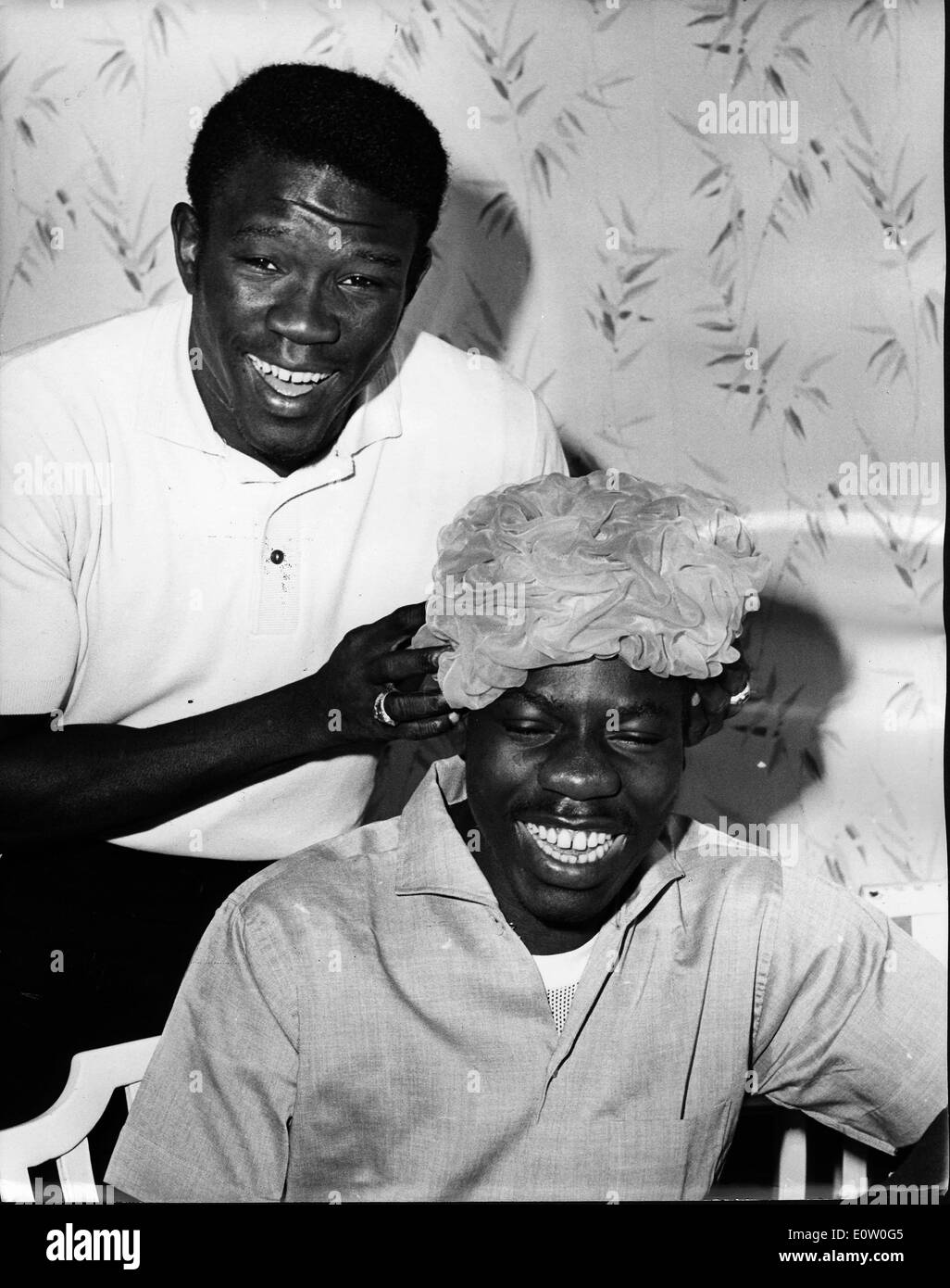 Boxer Emile Griffith goofing around with a friend - Stock Image