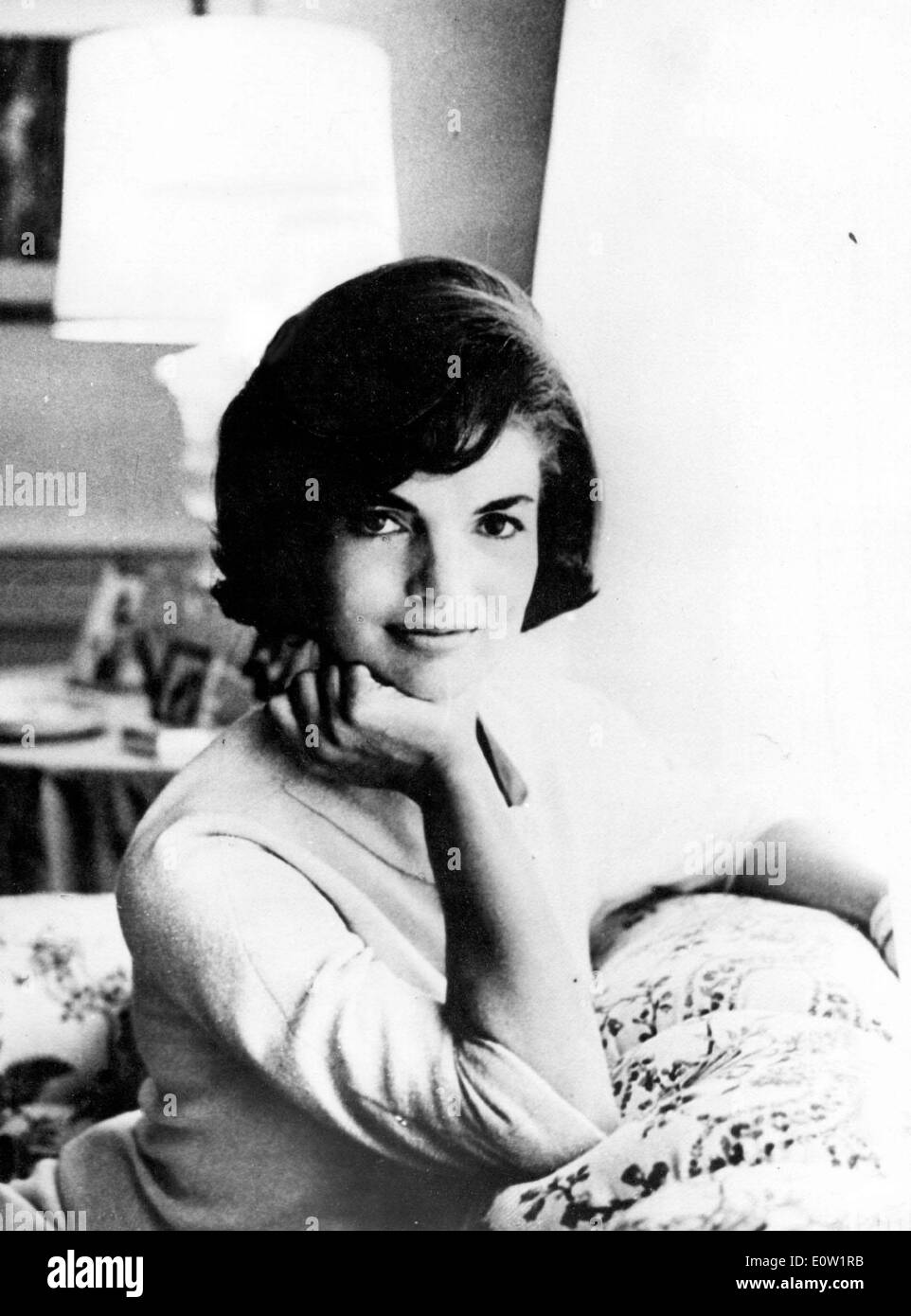 Portrait of First Lady Jackie Kennedy sitting on the sofa - Stock Image
