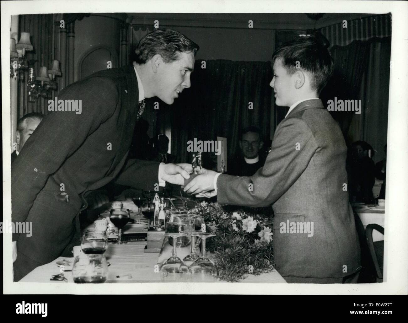Dec. 12, 1960 - Antony Armstrong Jones Presents Prizes. First Engagement Without Princess Margaret. Anthony Armstrong Jones, today carried out his first solo engagement with out Princess Margaret, when he went to attend a luncheon at the Dorchester Hotel, at which he presented the prize in the 1960 Schools' National Photographic Competition. OPS: Antony Armstrong Jones presents the Junior Trophy in the competition to 11 years old David Martin, of Abermad School, Aberystwyth, Cardiganshire. - Stock Image