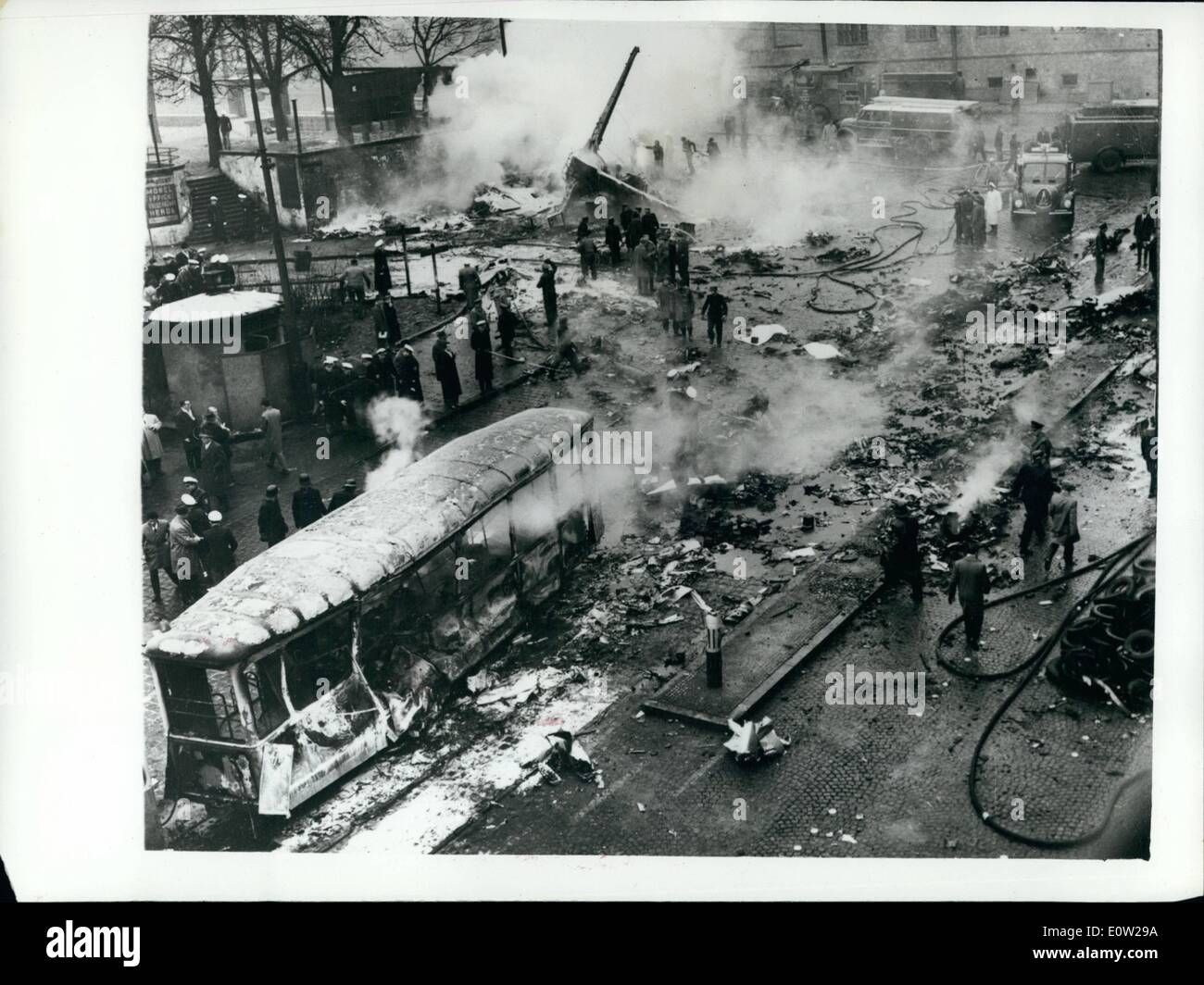 Dec. 17, 1960 - 17-12-60 Aircraft disaster in Munich. Students in machine on way to London for Christmas holiday. An inferno of flames swept the main street of Munich, Germany this afternoon when a Convair Transport aircraft of the United States Air Force crashed on to a tramcar filled with Christmas shoppers. Thirty people are believed to have been killed in the tram. It is believed that there may be some survivors from the aircraft which was carrying 13 American students on their way to spend Christmas with parents in England and a crew of seven. The machine was a U.S - Stock Image
