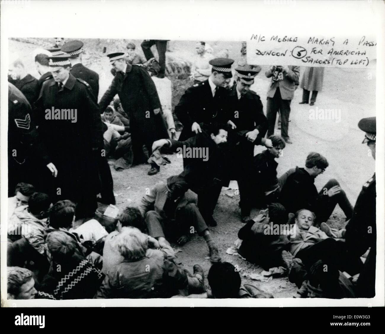May 22, 1961 - 22-5-61 Police remove demonstrators from Polaris Base. Police struggled to remove demonstrators who squatted in the roadway etc., at the Holy Loch today where the American Nuclear Submarine Polaris is stationed. Keystone Photo Shows: Police man-handled the squatters to remove them from the scene around the Holy Loch today. - Stock Image