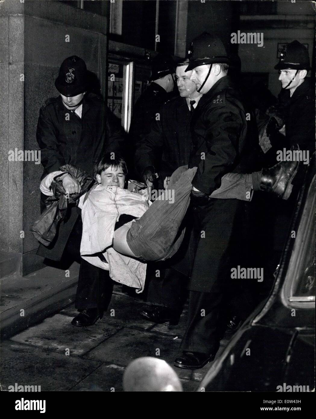 Apr. 04, 1961 - Police Fight Battles with Demonstrators.- A Few Hours After the Trafalgar Square rally at the end of the Ban the Bomb marches from wethersfield and Aldermaston Yesterday, police fought two battles with ban-the bomb demonstrators. the trouble started when 500 demonstrators.sat down in and refused to move. Two of their leaders were arrested and taken to West End Central police station Saville Row, and 200 of the demonstrators surged down the road to the police station to protest - Stock Image
