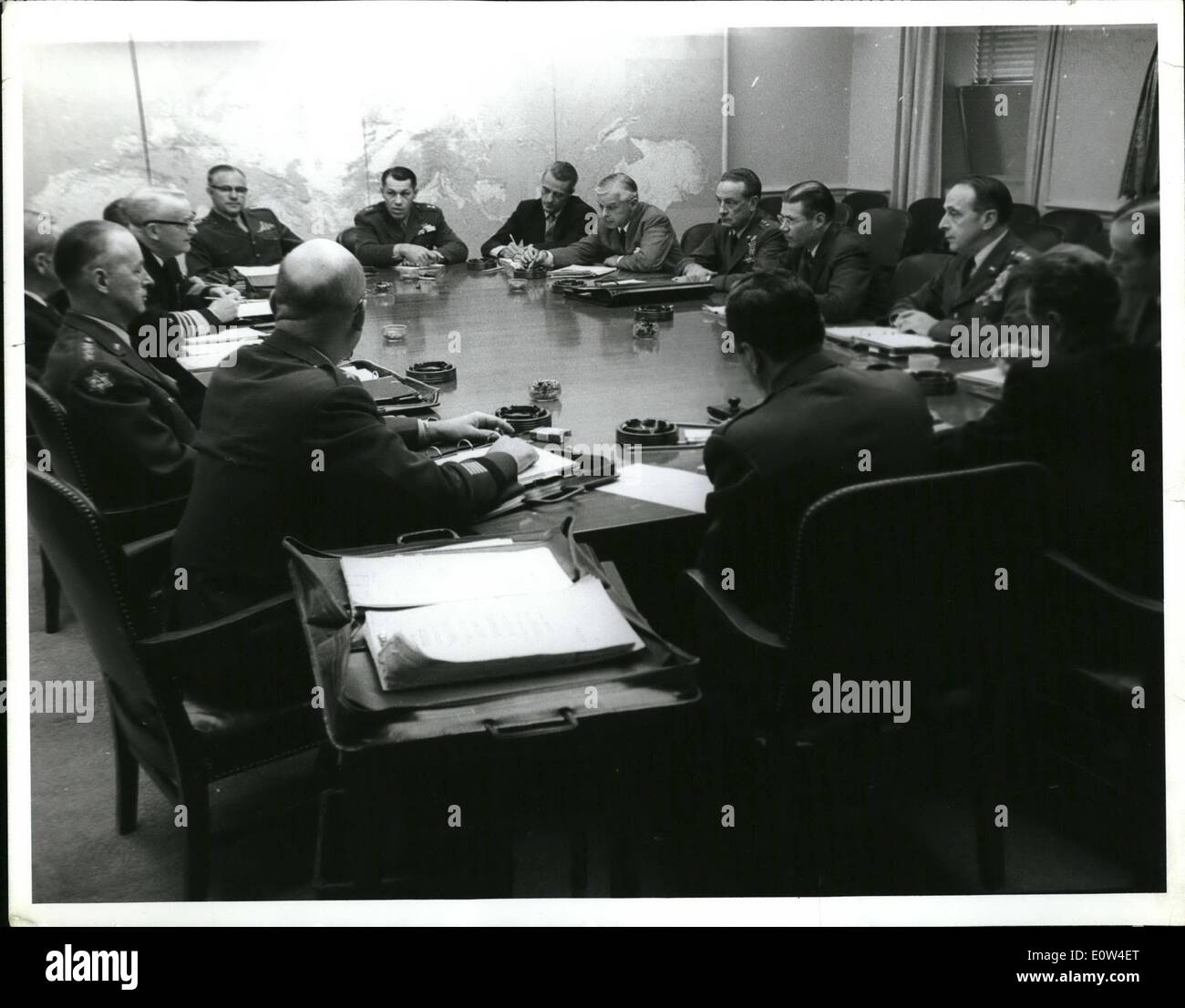 Apr. 04, 1961 - Secretary of Defense Robert S. McNamara and other Dept. of Defense officials meet with members of the Joint Chiefs of Staff and Joint Staff, at the Pentagon. (L to R, clockwise): Lt. Gen. Barksdale Hamlett, Deputy COFS for Military Operations, USA; General Clyde D. Eddleman, Vice COFS, USA; Deputy Secretary of Defense Roswell L. Gilpatric, Admiral Arleigh A. Burke, Chief of Naval Operations; Vice Admiral Ulysses S. G. Sharp, Jr., (partially visible) Deputy Chief of Naval Operations for Plans and Policy; General David M. Shoup, Commandant, USMC; Maj. Gen. Frederick L - Stock Image