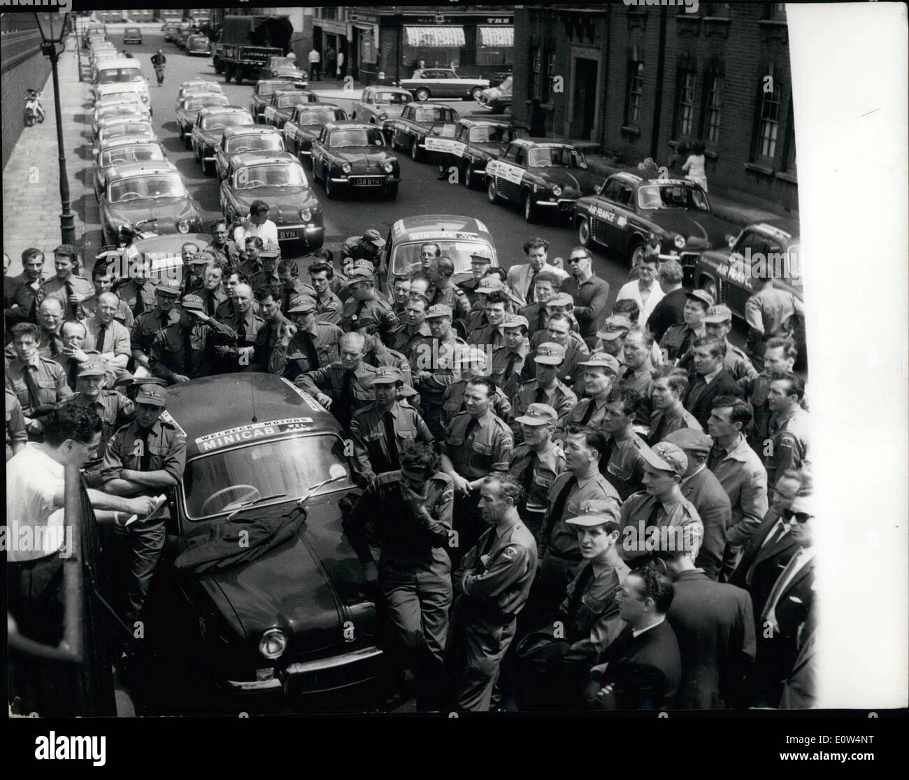 Jun. 06, 1961 - THE ''MINICAB versus TAXICAB'' - BATTLE STARTS TODAY. The battle of the fares is expected to start today-when 200 red DAUPHINE Minicabs go into service in London against 9,000 taximen facing the biggest ever threat to their monopoly...The cabs are run by WELBECK MOTORS - with MICHAEL GOTLA as the boss-and backed by millionaire tycoon ISAAC WOLFSON...The Minicabs will not ply for hire-like ordinary cabs-but will be booked and detailed by radio telephone.. - Stock Image