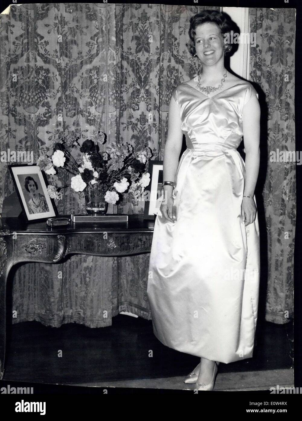 Apr. 16, 1961 - 16-4-61 Denmark's Princess celebrates 21st birthday in London. She wears a borrowed gown. Princess Margrethe of Denmark held her Key of the Castle party at the Danish Embassy in London this evening. The Princess who is studying Archaeology in Cambridge arrived in London only just in time for the party from her Easter Cavation in Norway because of the Danish Transport strike which also delayed the arrival of her party gown so she had to borrow a dress. Keystone Photo Shows: Princess Margrethe in her borrowed gown this evening. It is in yellow satin. - Stock Image