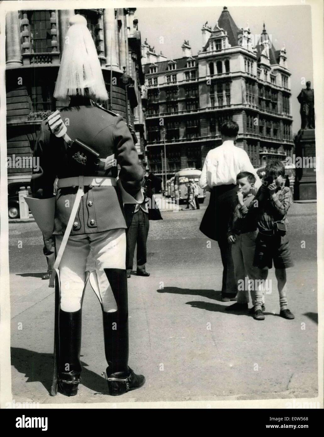 Jun. 24, 1961 - Hot Weather Scenes - In London The Guard Is Very Warm: With the temperature well up in the seventies - it was shirt-sleeve order in London this afternoon. Photo shows Ten years old John Duhigg of Bermondsey, London - uses his camera to get a snap of the Horse Guard - at Horse Guards Parade this afternoon. Looking on is nine year old Chris Clifford - also of Bermondsey. - Stock Image