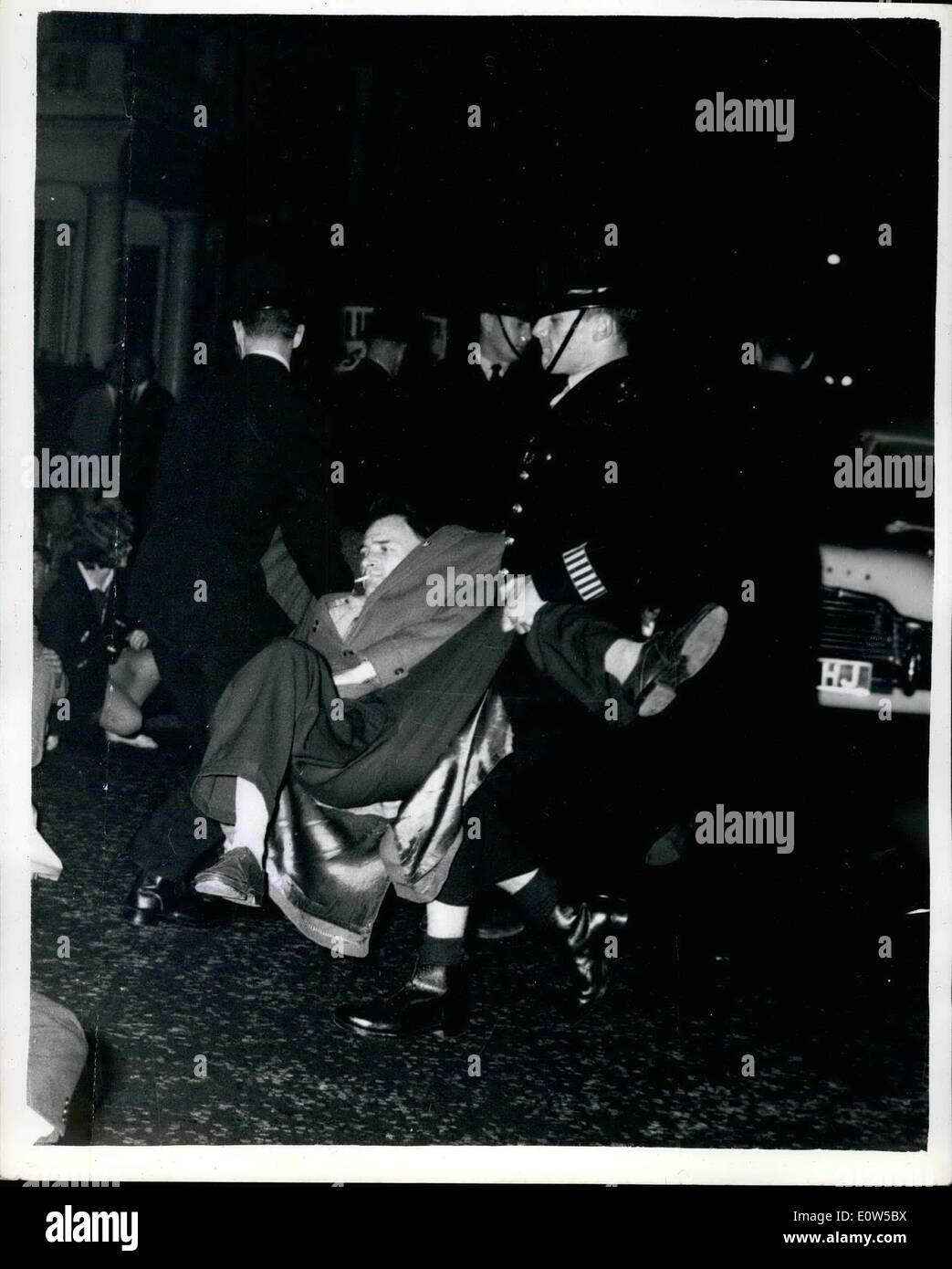 Sep. 09, 1961 - Anti-Bomb Marchers held.. Demonstration in London: Police arrested 120 anti-Bomb demonstrators in the West End of London last night after halting a protest march on the American Embassy... The marchers are supporters of a committee of 100- the group headed by Bertran Russell which is organizing a passive civil disobedience campaign in support of nuclear disarmament. They will appear at Marlborugh street this morning. Picture Shows: Police removing some of the demonstrators- in the West End of London last night.. 120 will appear in court today. - Stock Image