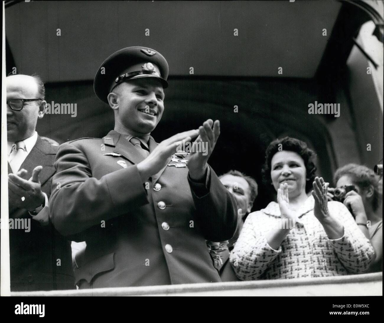 Jul. 07, 1961 - Yuri Gagarin in London for Russian Trade Fair. The Soviet spaceman, Yuri Gagarin, arrived in London yesterday for a three-day visit. Thousands of Londoners turned out to welcome him. Gagarin is here to attend the Russian Trade Fair now being held at Earl's Court. Photo Shows: Gagarin clapping hands while standing on the balcony of the Russian Embassy in Kensington Palace Gardens shortly after his arrival yesterday. Keystone - Stock Image