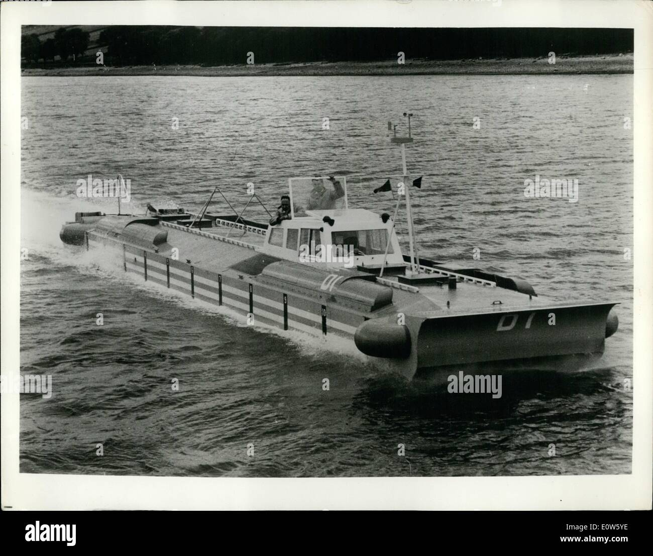 Jul. 07, 1961 - Hovering Ship: Undergoing trials on Gare Loch, Scotland, is the D1, a 60 feet, experimental prototype ''hover ship''. Weighing 4 1/2 long tons, it has two three cylinder two cycle 25 b.h.p. engines which raise its bottom from the water while its side walls remain submerged to about six inches. Two 35 b.h.p. outboard engines with variable pitch propellers ''sled'' it across the water. Its British builders hope to have a passenger-carrying version in operation by the end of next year. - Stock Image