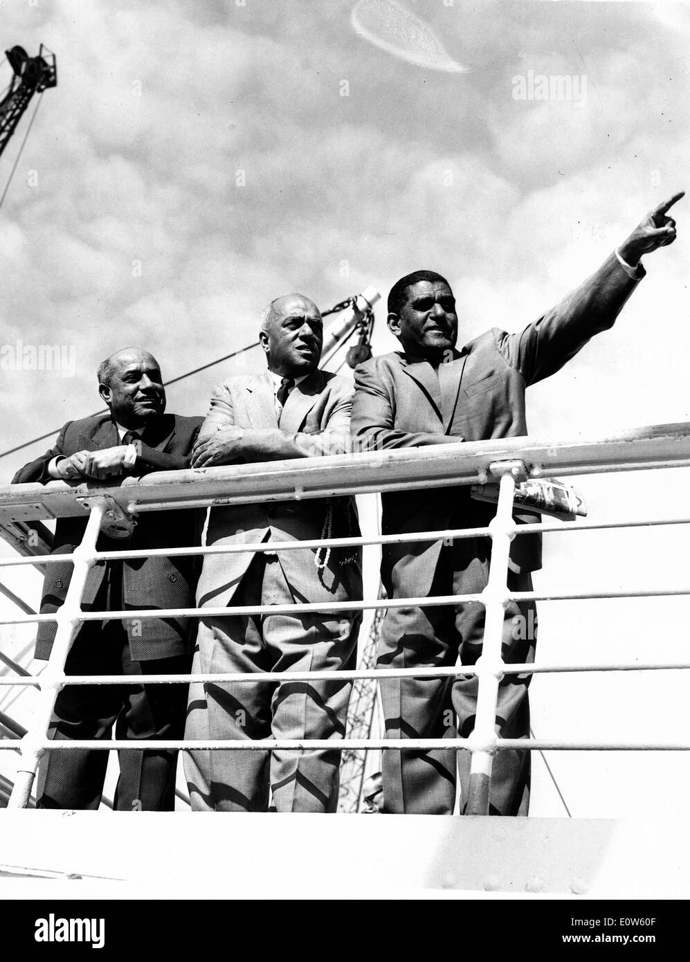 Jul 14, 1961; London, UK; The three Bahreini Arabs were sentenced in Bahrein in 1956 on charges of attempting to overthrow the Government and to assissinate the Ruler, Sheikh Sulman Bin Hamad al Khalifah. Leaning on the rails of the liner Warwick Castle when she arrived at King George V Dock are the three Bahreini Arabs (L-R) ABDUL RAHMAN BAKER, ABDUL ALI ALAIWAT and ABDUL AZIZ SHAMLAN. - Stock Image
