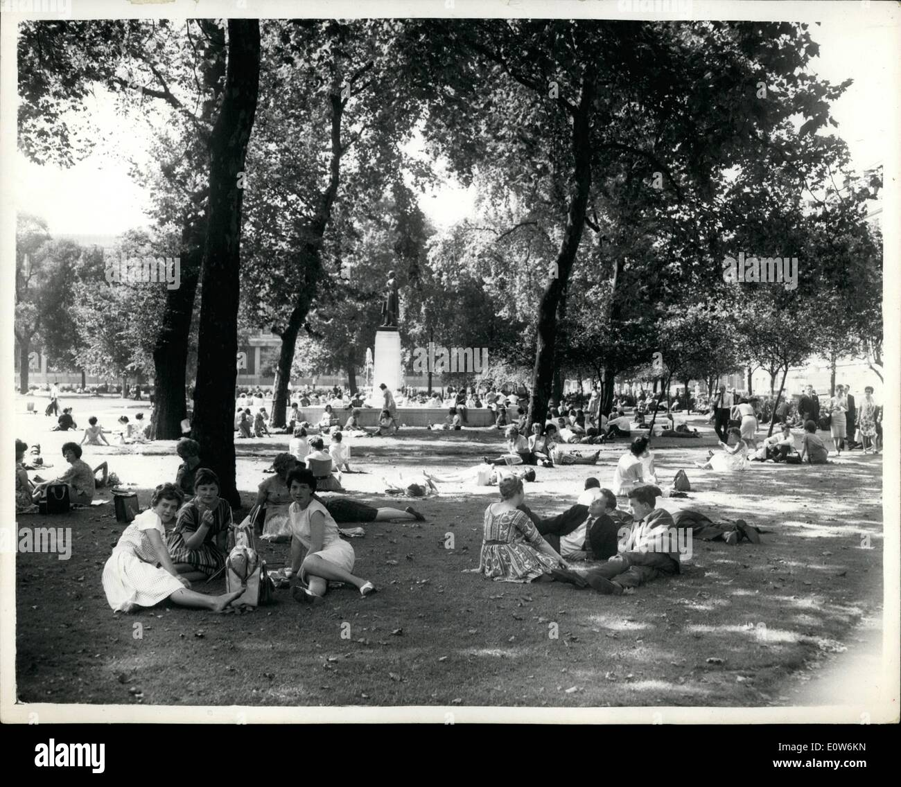 Aug. 08, 1961 - Hot Weather Comes Back To London: After weeks of dismally poor weather, it seems that warmer temperatures have returned - however temporarily - to London. Photo shows Londoners sitting in Grosvenor Square, Mayfair, today as the mercury once again started its upward climb. - Stock Image