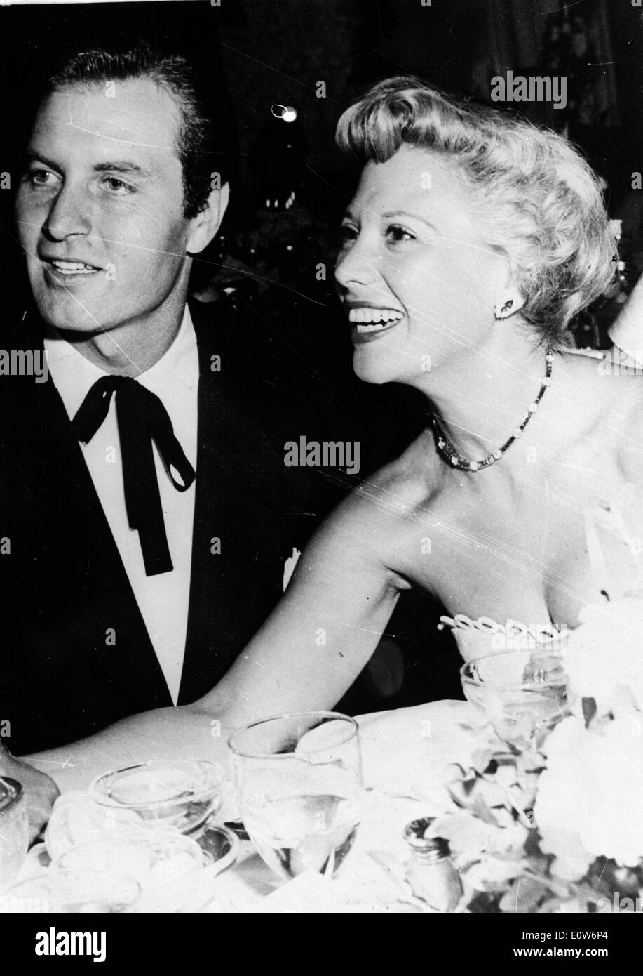 Singer Dinah Shore at a dinner with husband George Montgomery - Stock Image