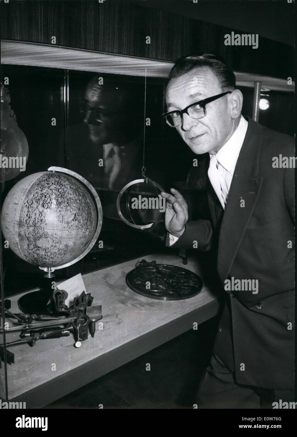 Dec. 12, 1961 - First German Moon Globe.: After nearly ten years of work, engraver Alfred Schlegel (Schlegel) of selb in Upper Franconia/West-German has made a globe of the moon. Precise Photographies of the side looking towards the earth were the basic for the being of his works. Later, Schlegel received pictures of the back side of the moon from American scientists. The moon globe has a diameter of 34 centimeter and consists of 12 segments. 400 craters are seen on the back side of the moon alone, 16of them were named after famous scientist of East and West - Stock Image