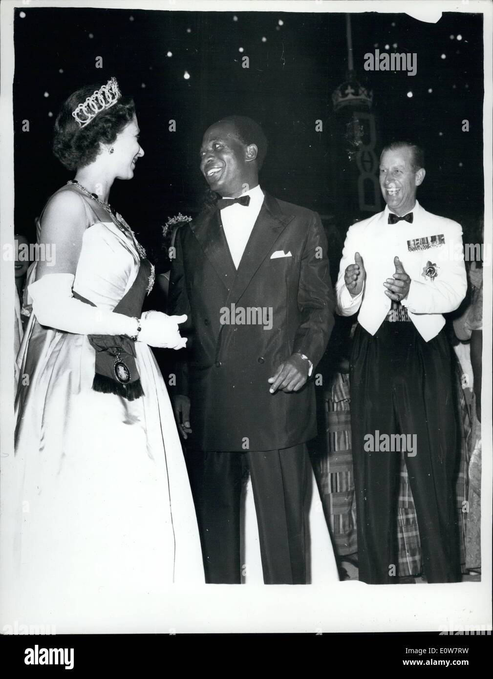 Nov. 11, 1961 - Queen Dances The ''High Life'' With Dr. Nkrumah. Night Out In Accra - Ghana: The Duke Of Edinburgh applauds - as H.M. The Queen and Dr. Nkrumah end their dance the ''High Life'' -during a ball at State House, Accra, Ghana - during the week-end. ''High Life is a Ghanian speciality - ma sort of cross between the Shimmy and the Charleston - in which the feet go one way - and the hips another. - Stock Image