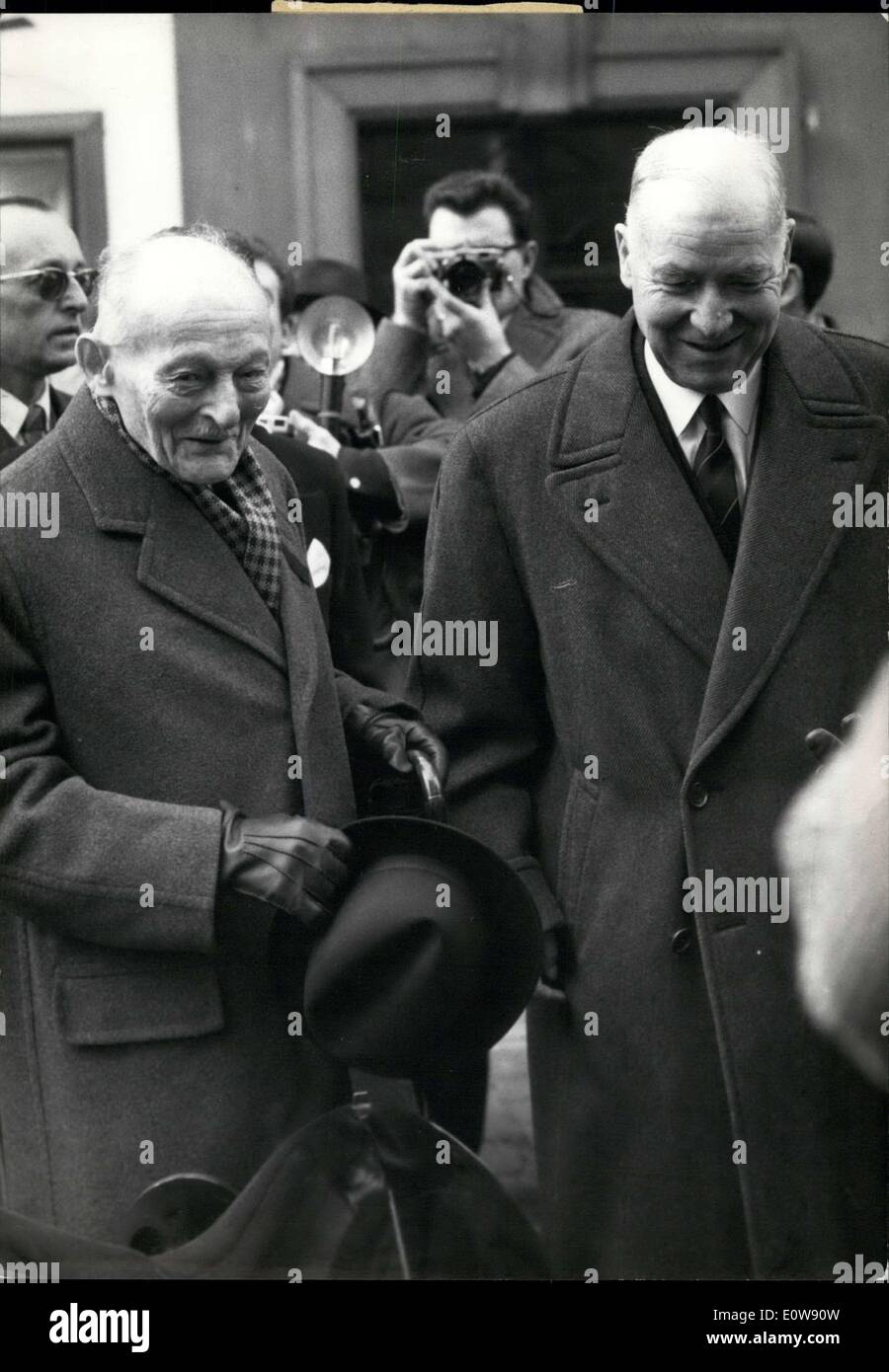 Feb. 02, 1962 - Funeral services for Mrs. Philippe Petain were held at Saint-Pierre-du-Gros-Caillou Church this morning. General Weygand and Marshall Juin exit the church with smiles on account of the sympathetic crowd. - Stock Image