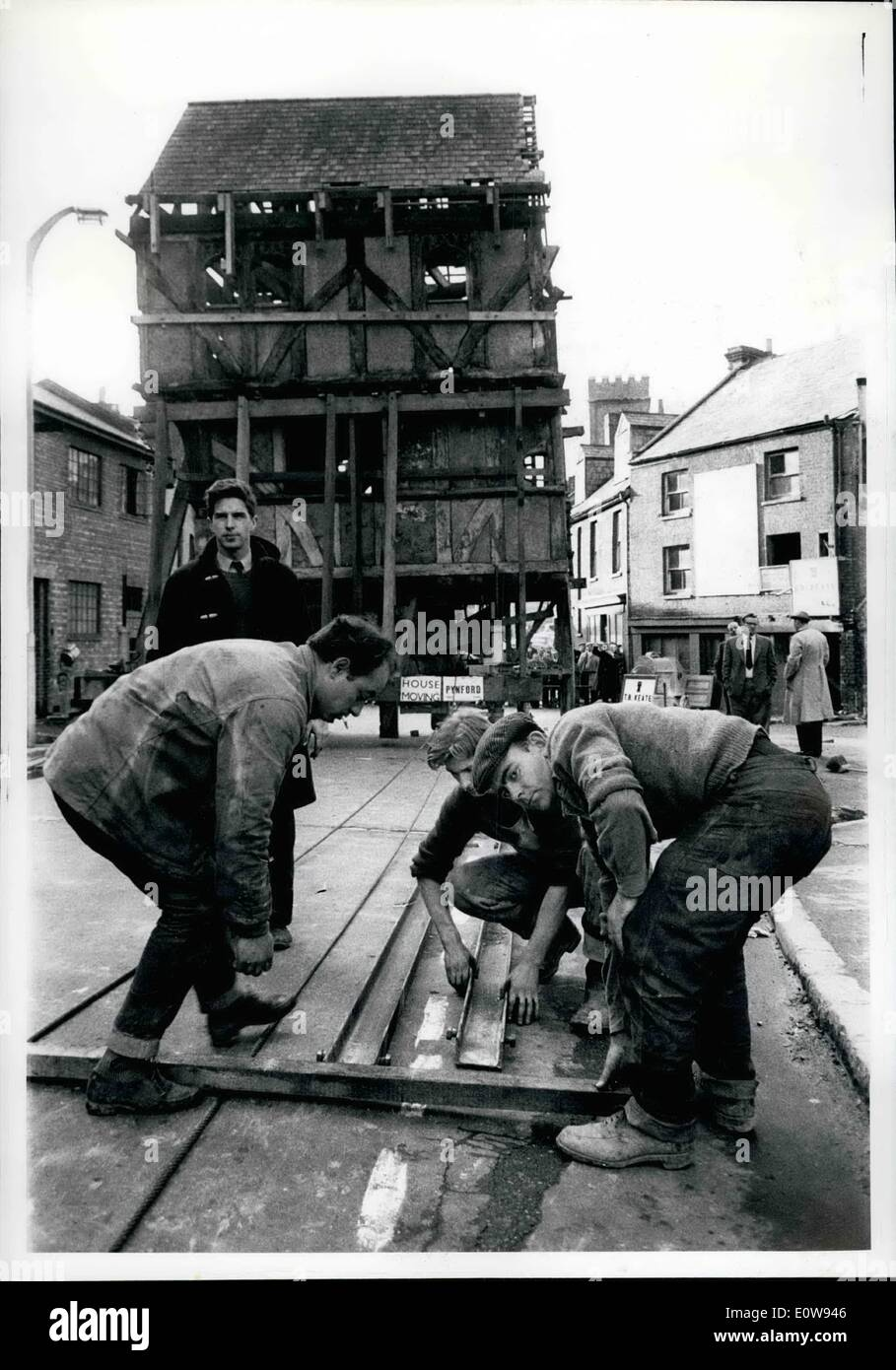 Dec. 12, 1961 - Daily Herald. London. Historic House Moved. A 14th cent. old half timbered house in Exeter, Devon, has had to be moved 300 feet because it was in the middle of a new road way which is being constructed. For over a month workman have been crating the building and today it was up a slope with a 1 in 10 gradient. One of the dangers was that the three storey building would topple over and great care had to be taken, hydraulic jacks were used to keep it level. The move taken because of the protests when it was suggested that the building should be demolished, is costing about ,000 - Stock Image