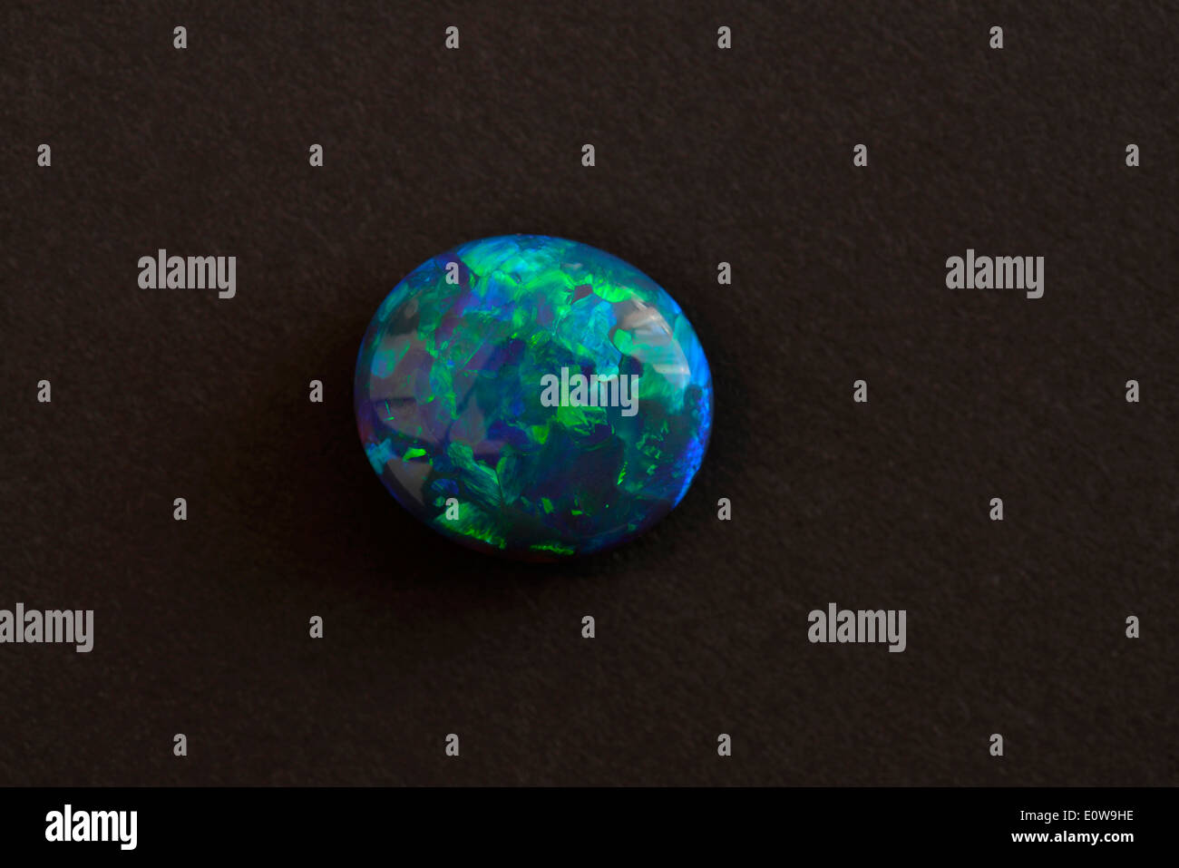 Polished Black Opal, studio picture against a black background - Stock Image