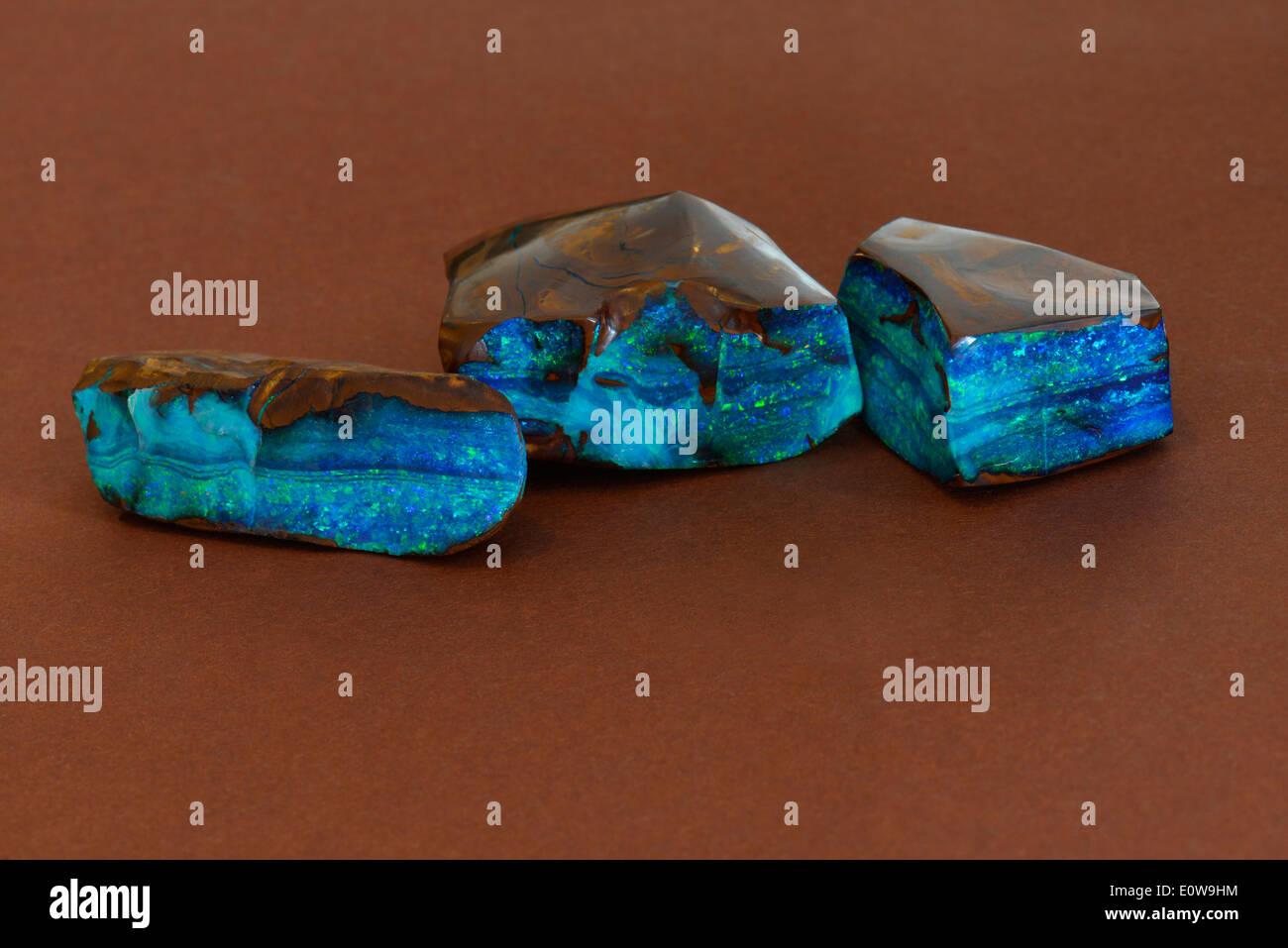 Polished Boulder Opal, studio picture against a black background - Stock Image