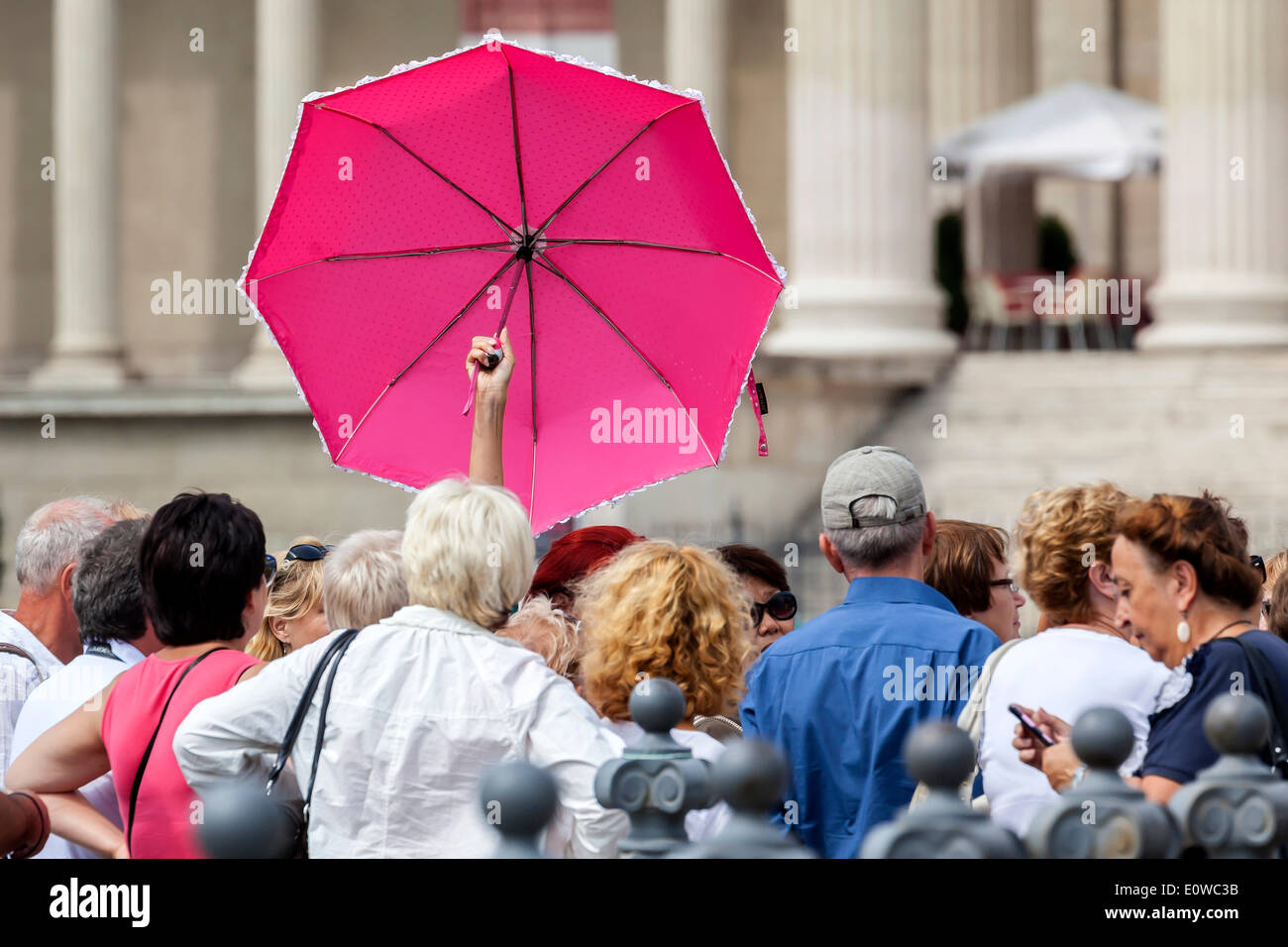 Group of tourists with a tour guide holding a pink umbrella, Budapest, Hungary - Stock Image