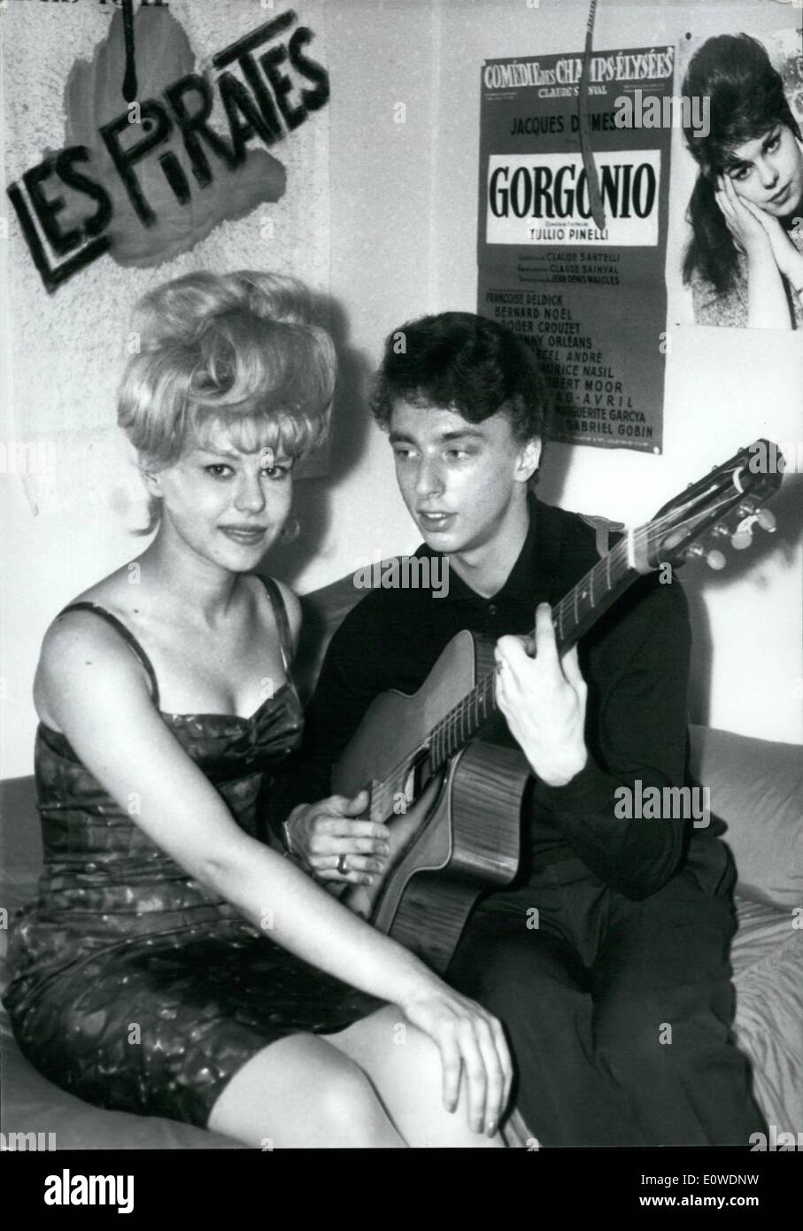 Jun. 06, 1962 - The Pirates Wedding: French Jazz men team ''The Pirates'' will have a wedding party. Their guitarist gets married. Photos shows Jean Veidlg plays the guitar for his fiance, young starlett Francoise Deldick. - Stock Image
