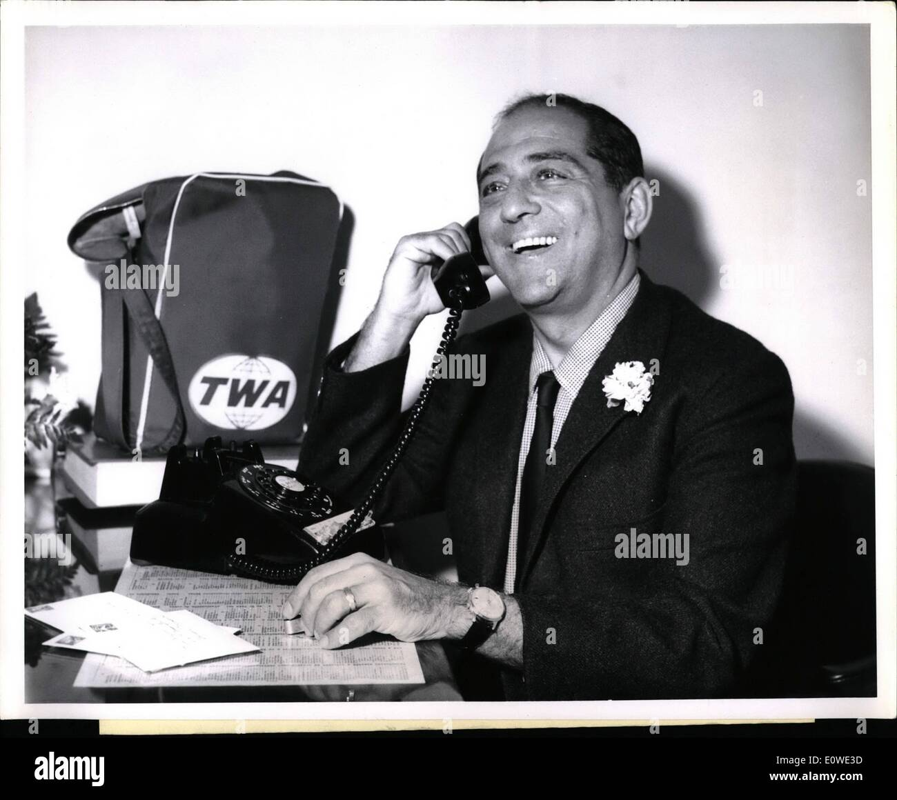 Jul. 07, 1962 - The Metropolitan Opera's baritone Robert Merrill seems to be enjoying this last minute phone call at the Trans World Flight Center, prior to boarding a TWA SuperJet to Rome for three weeks there and in Florence, where he will record Puccini's ''Ii Tabarro'' with Renate Tebaldi, for London Records. Credits: TWA - Stock Image