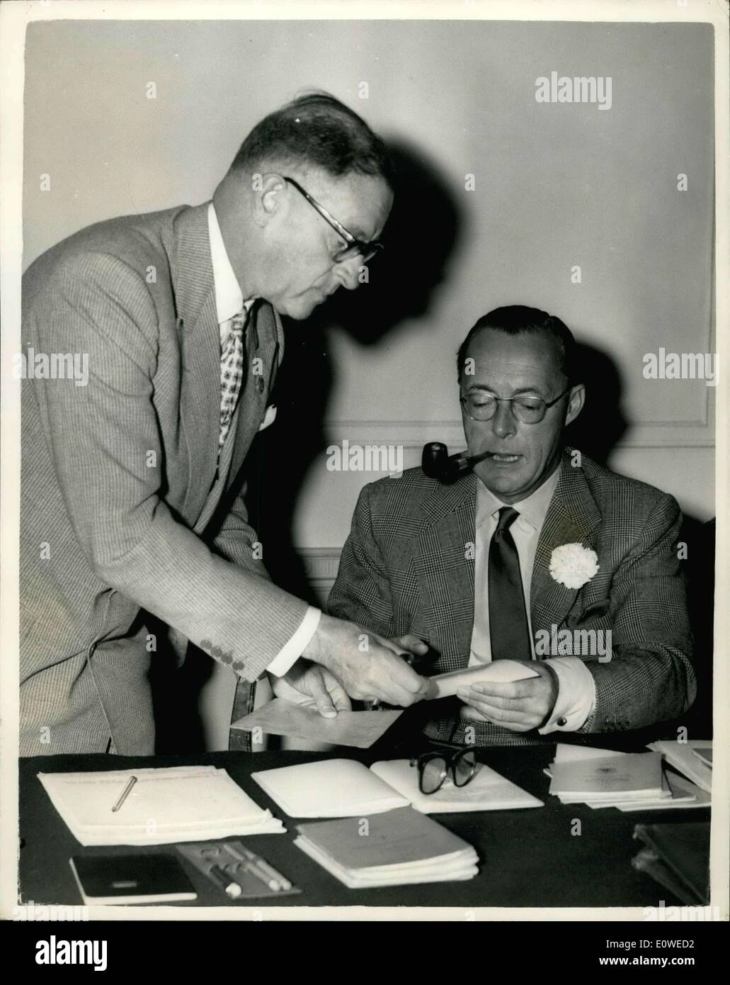 Jul. 20, 1962 - The Annual Meeting of The International Equestrian Federation For the first time since it was founded in 1927 the Executive Committee of the Federation Equestre Internationale (International Equestrian Federation - F.E.I) met at the offices of the British Horse Society, Bedford square, London. Prince Bernhard of the Netherlands took the chair. Photo Shows:- M.E.A. Sarasin - of Switzerland, (2nd. vice-president) talking over notes with Prince Bernhard of the Netherlands (Chairman) at the meeting. - Stock Image