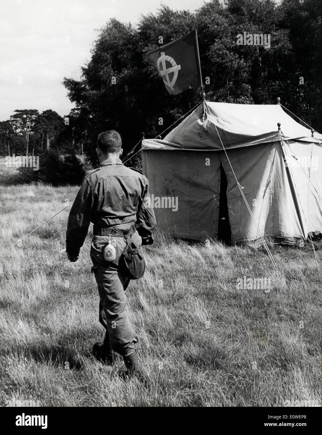 Neo nazi in paratrooper uniform walks past tent - Stock Image