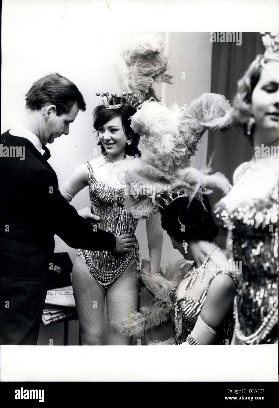 Aug. 11, 1962 - Show-girls from many well-known productions have their own department and always check the their outfits for perfect fit. Peter McAndrew of the ''Review'' department has the job of fitting the girls. - Stock Image